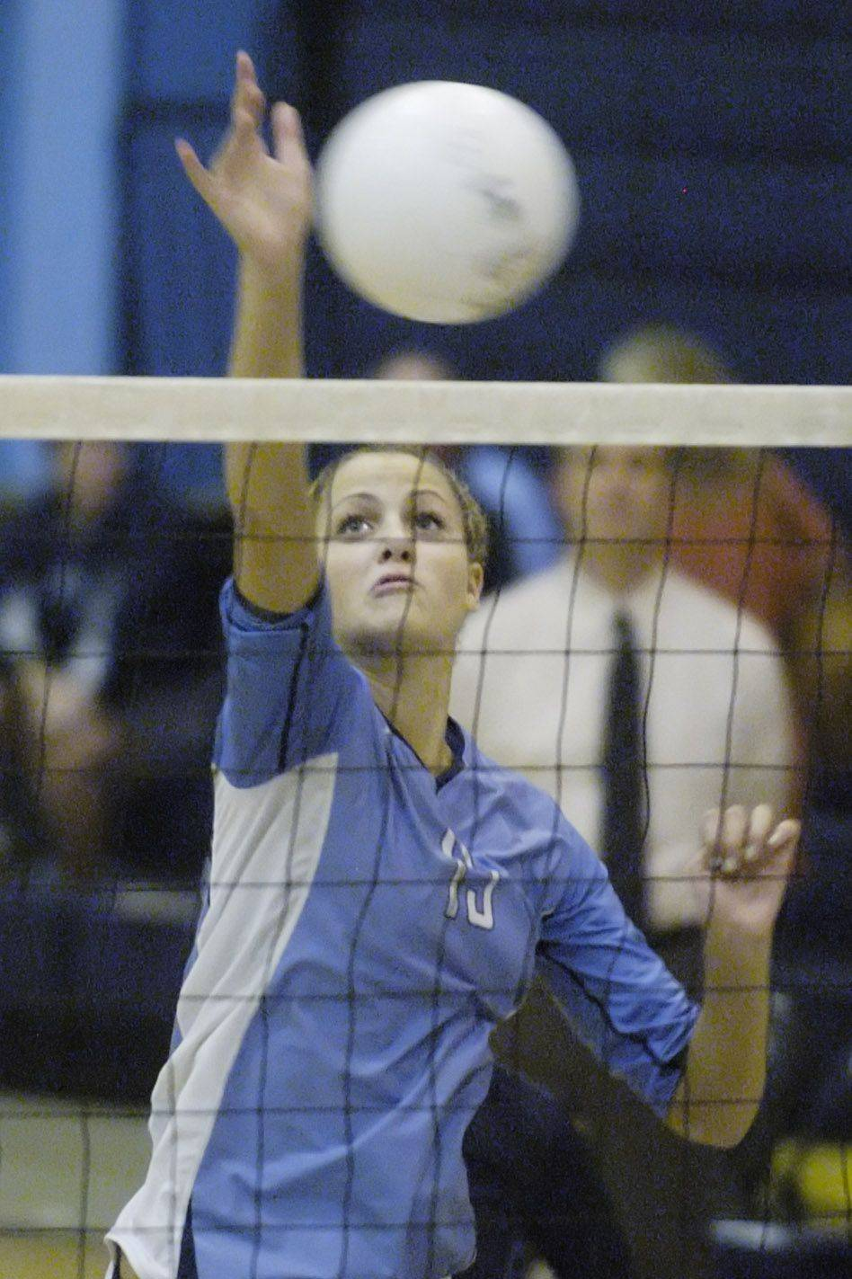 Prospect's Carly Thompson attempts a kill during Tuesday's game against Rolling Meadows.