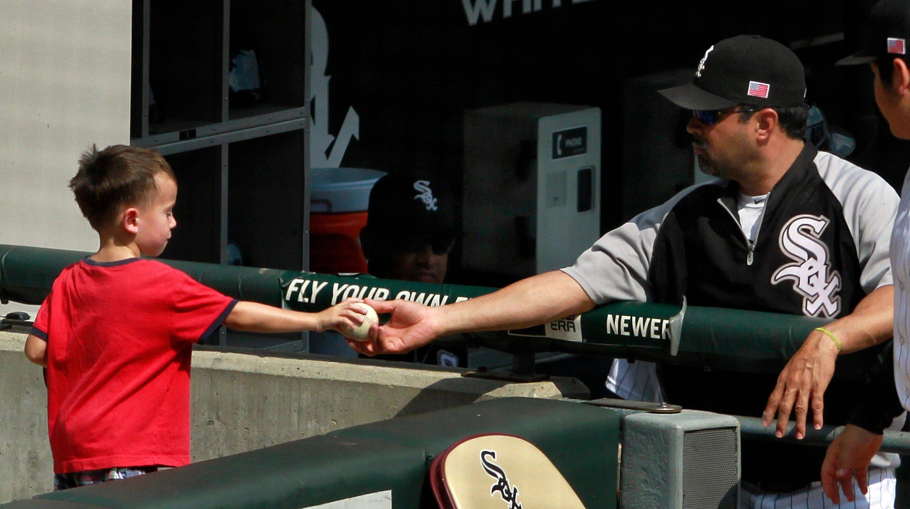 White Sox manager Ozzie Guillen, handing a young fan a baseball, says he has no idea whether he will be back for the 2012 season and takes the blame for this season's failures.