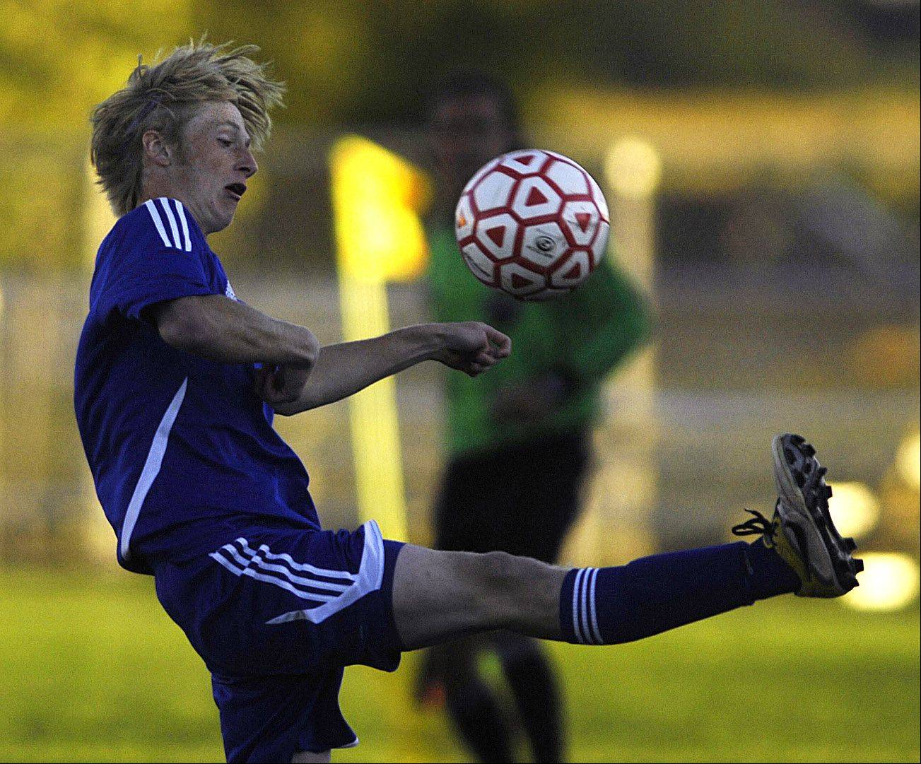 Geneva's David Goodyear saves the ball from the sidelines Tuesday in Batavia.