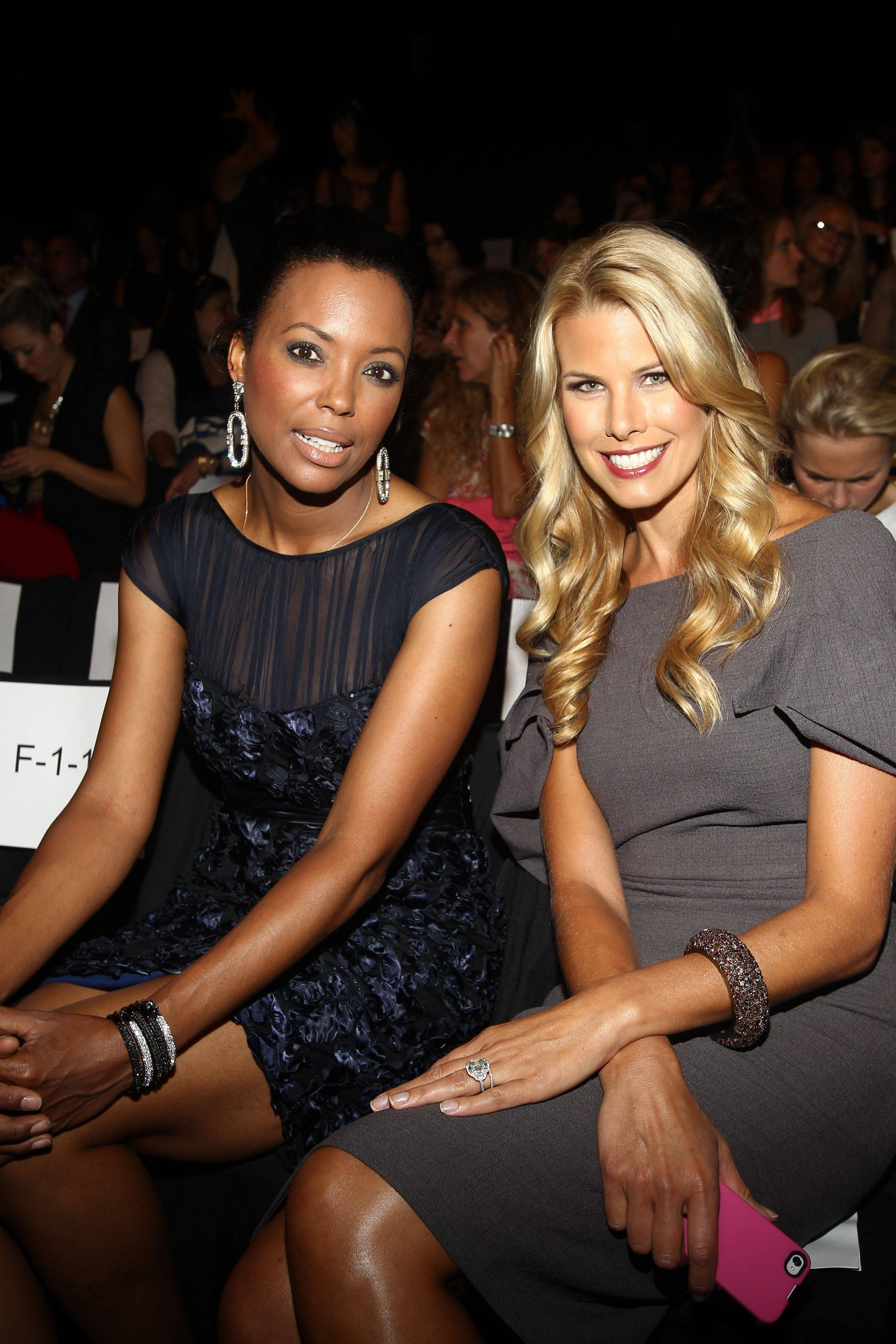 Actress Aisha Tyler, left, and Beth Ostrosky Stern attends the Badgley Mischka 2012 Spring collection during Mercedes Benz Fashion Week at Lincoln Center on Tuesday, Sept. 13, 2011.