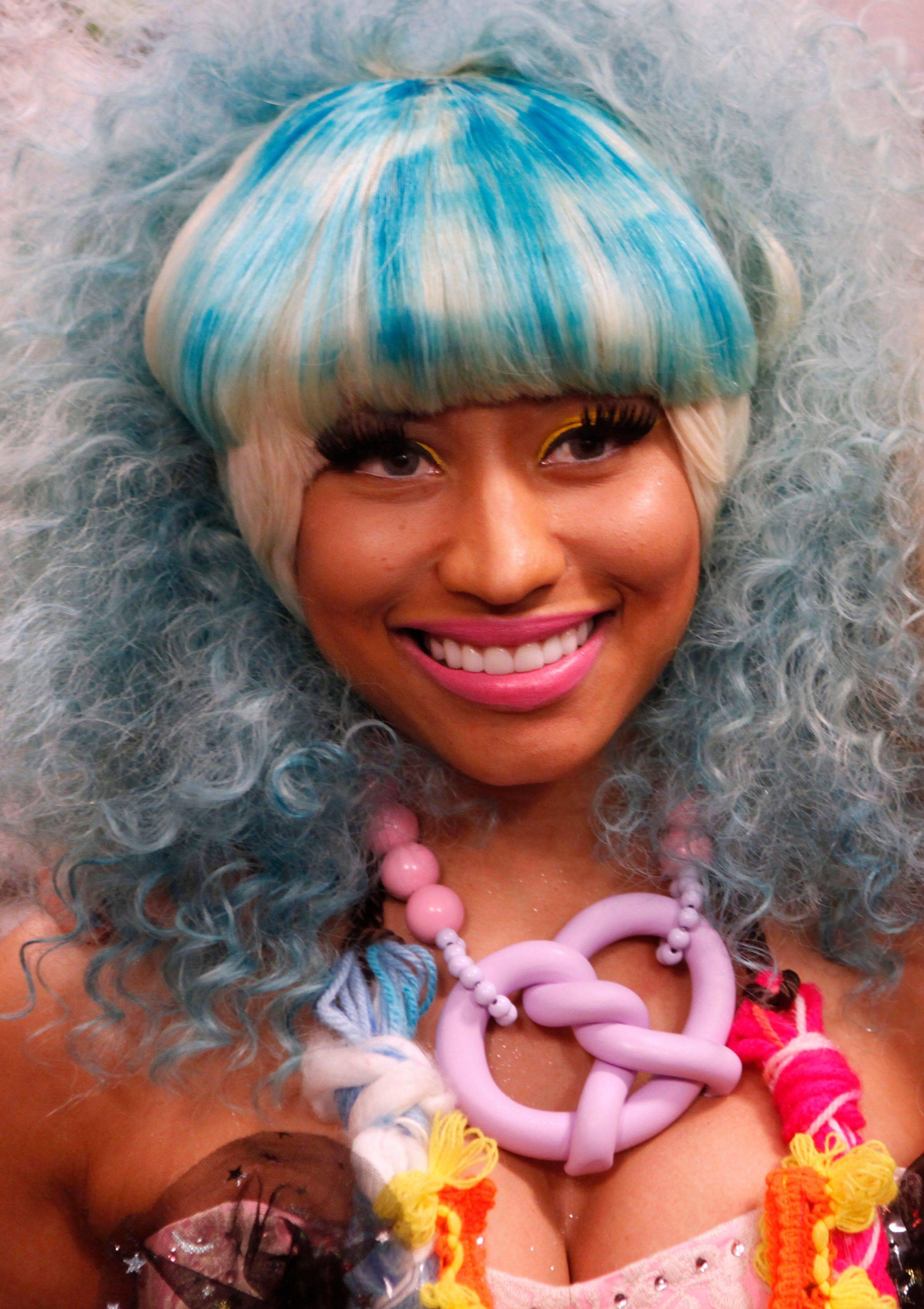 Singer Nicki Minaj poses backstage the Betsey Johnson Spring 2012 collection show during Fashion Week, Monday, Sept. 12, 2011, in New York.