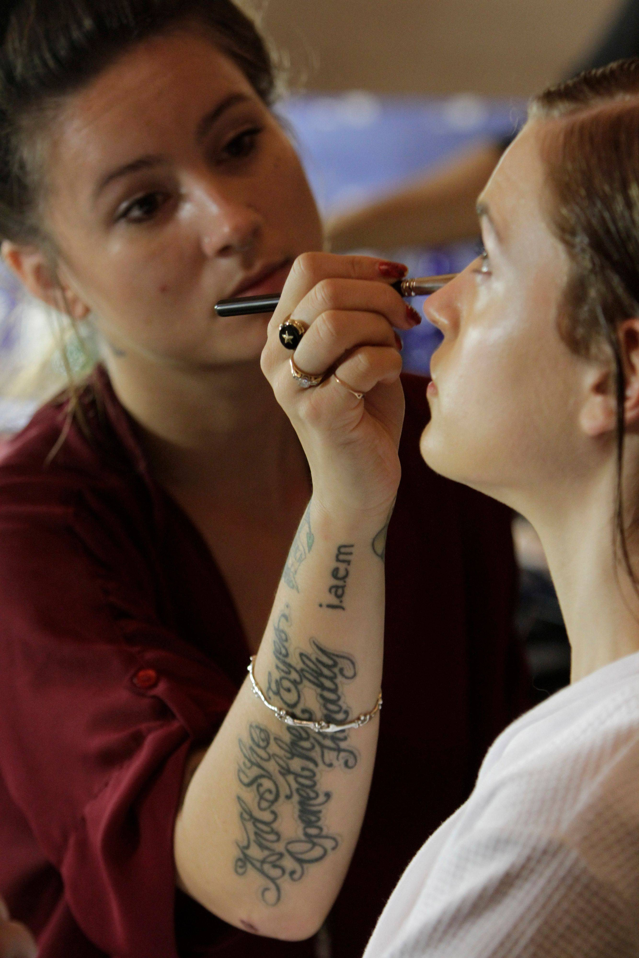 A model has her make up done backstage before the Marchesa Spring 2012 collection is modeled Tuesday, Sept. 13, 2011 during Fashion Week in New York.