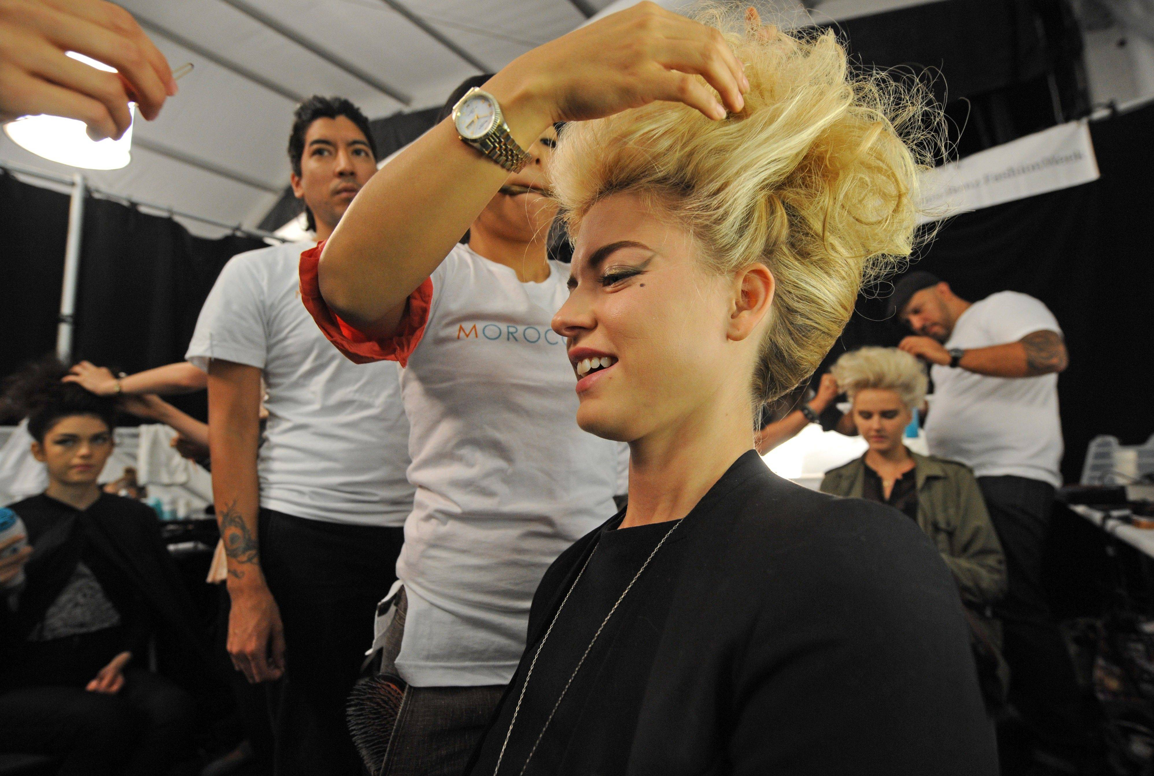 Models get prepped backstage at the Badgley Mischka Spring 2012 collection during Fashion Week, Tuesday, Sept.13, 2011, in New York.