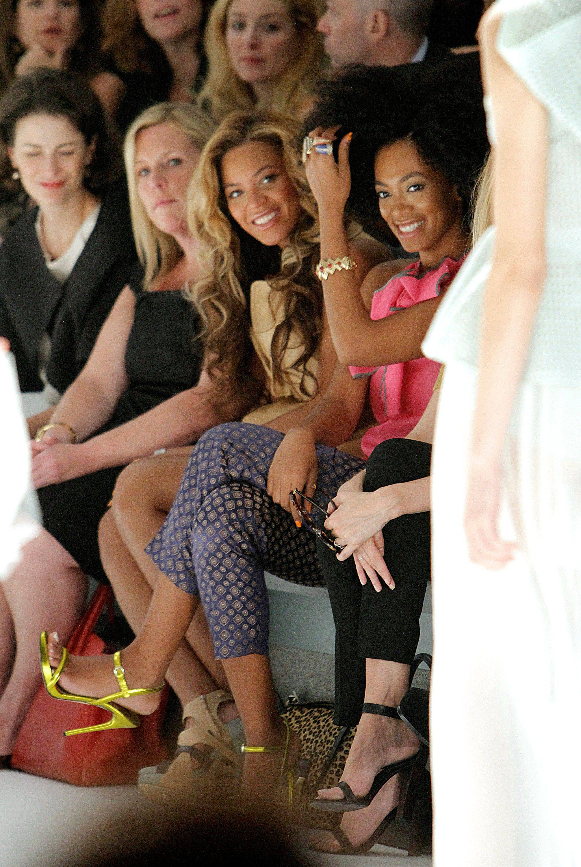 Singers Beyonce Knowles, center, and her sister Solange Knowles, seated right, attend the Vera Wang 2012 Spring collection during Mercedes Benz Fashion Week at Lincoln Center on Tuesday, Sept. 13, 2011.