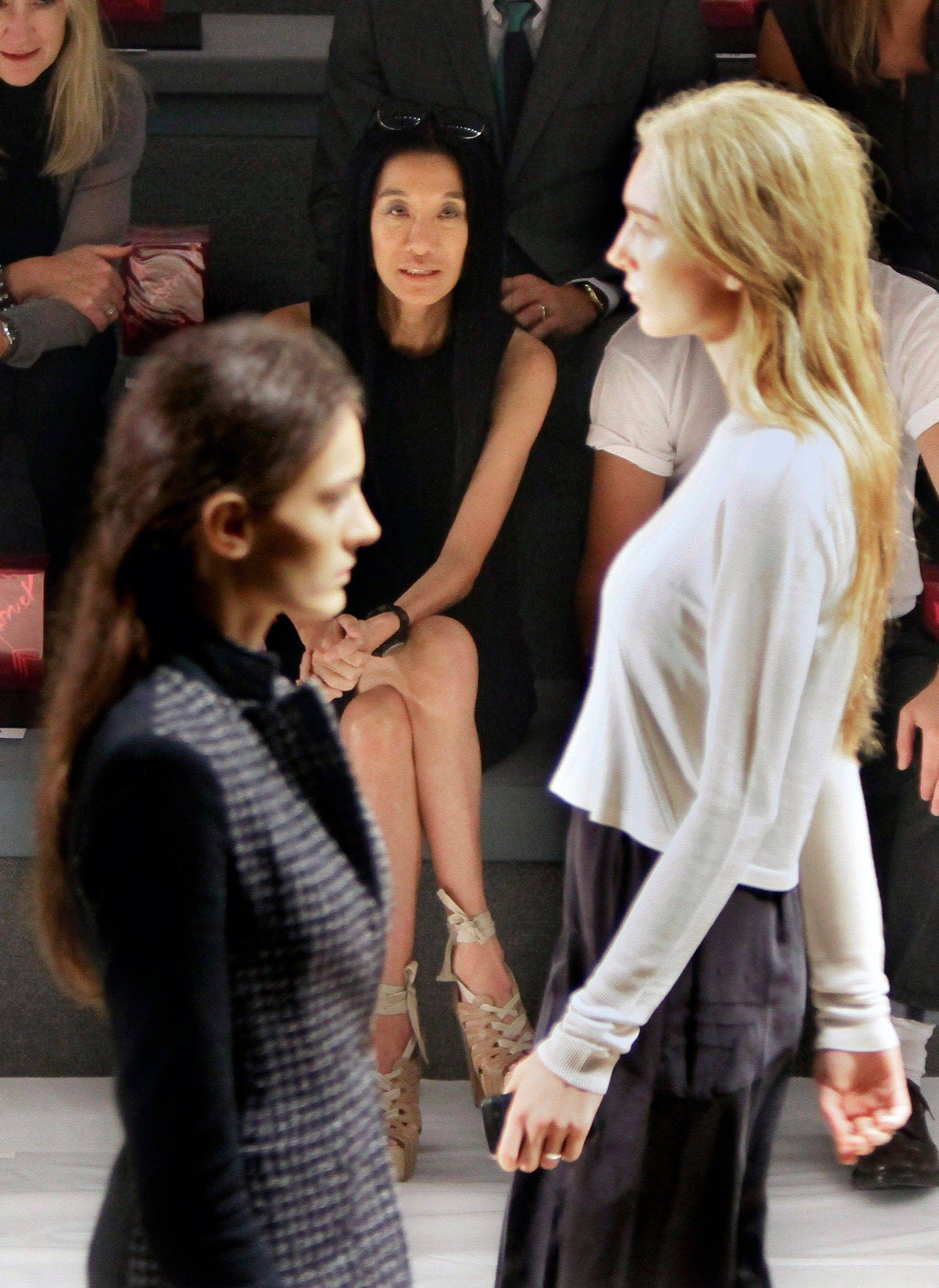 Fashion designer Vera Wang, center, rehearses models for the presentation of her Spring 2012 collection on Tuesday, Sept. 13, 2011, during Fashion Week in New York.