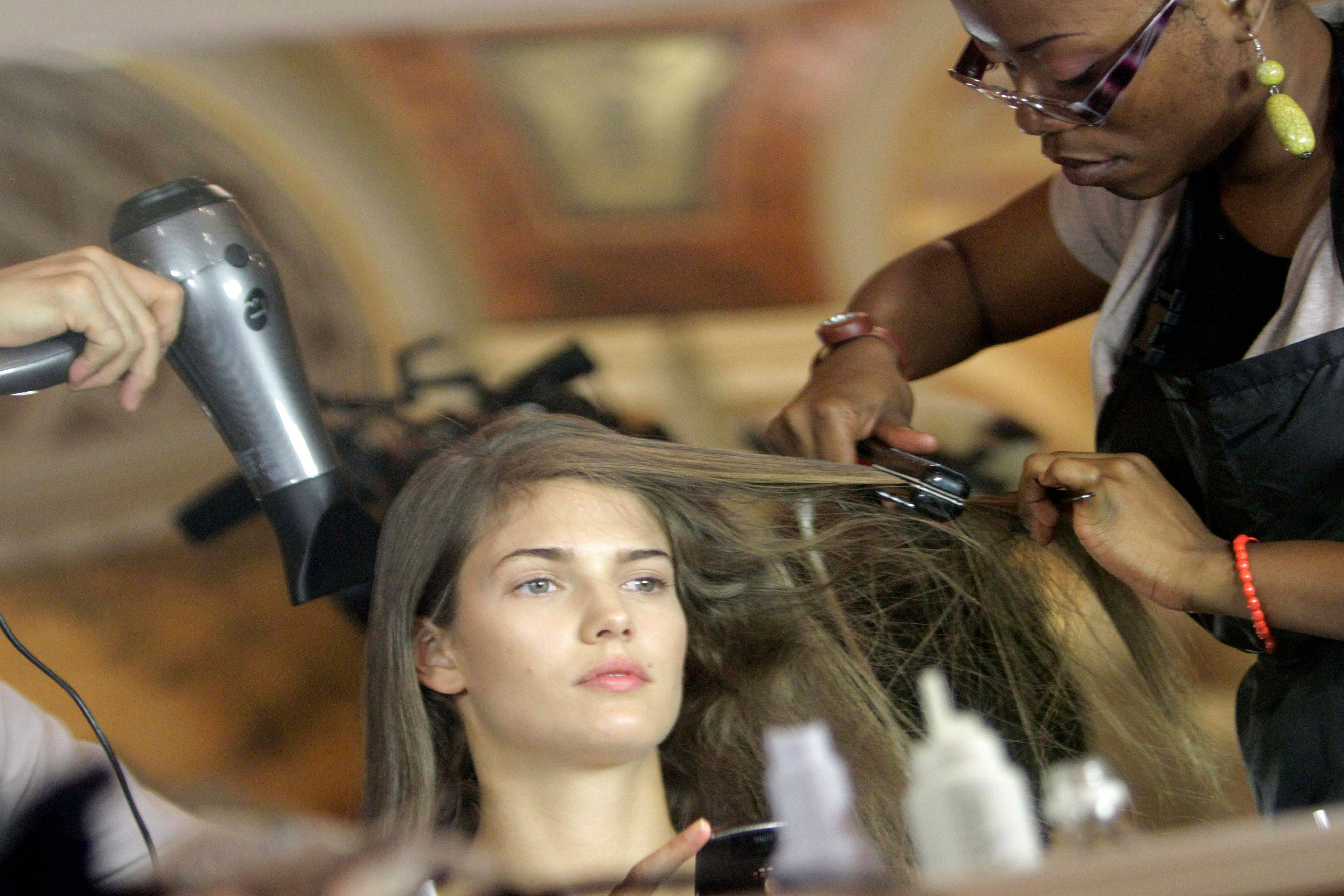 A model has her hair done backstage before the Marchesa Spring 2012 collection is modeled Tuesday, Sept. 13, 2011 during Fashion Week in New York.
