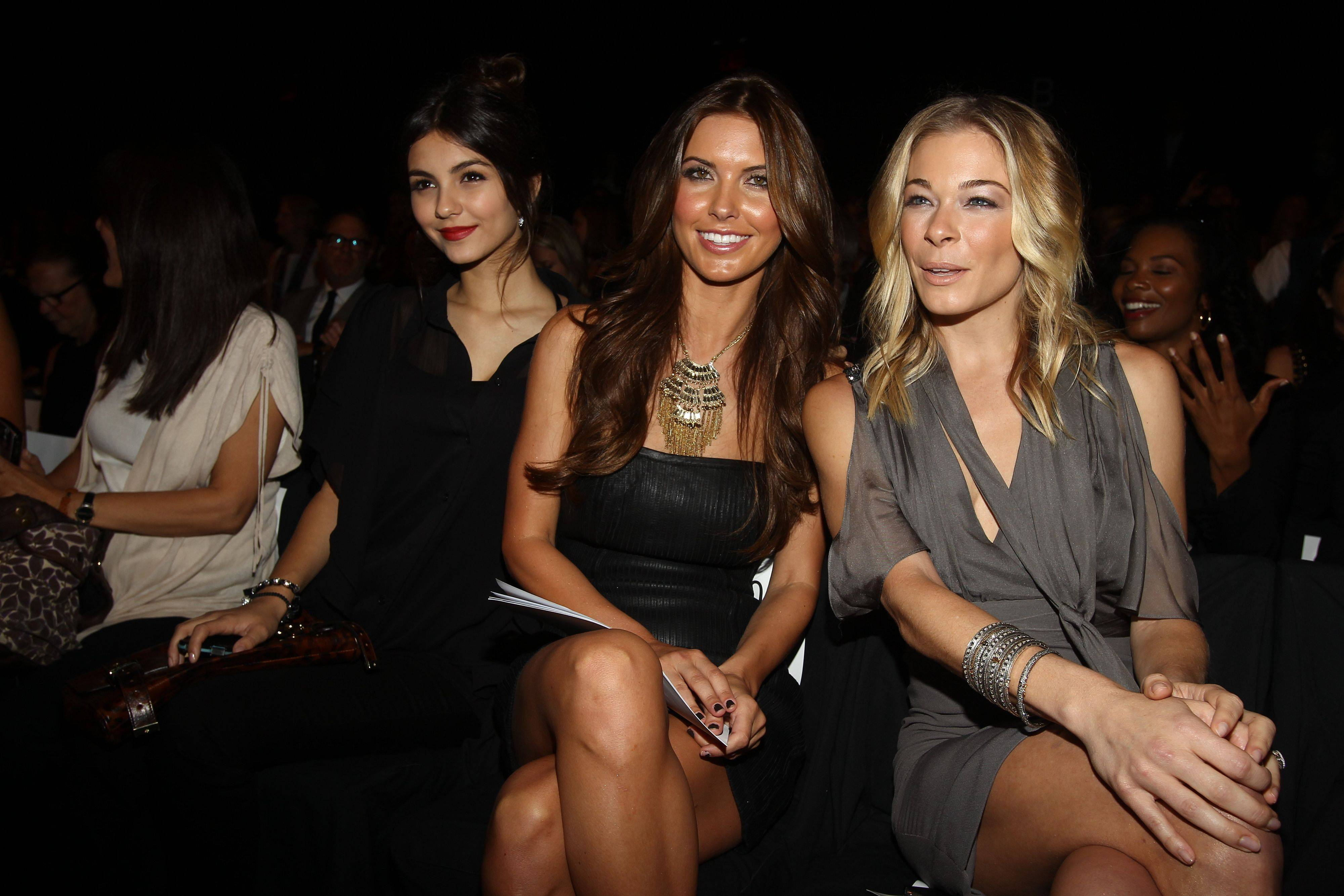 Actress Victoria Justice, left, TV personality Audrina Patridge, center, and singer Leann Rimes attends the Badgley Mischka 2012 Spring collection during Mercedes Benz Fashion Week at Lincoln Center on Tuesday, Sept. 13, 2011.