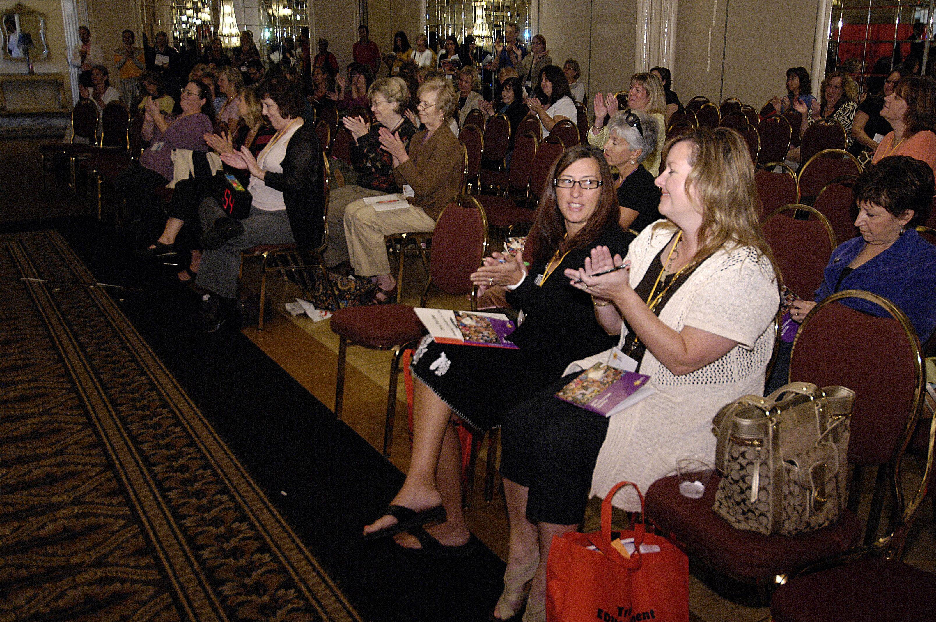 Teachers and parents watch educational performers display their talents Tuesday at the Premier Showcase in Lombard.
