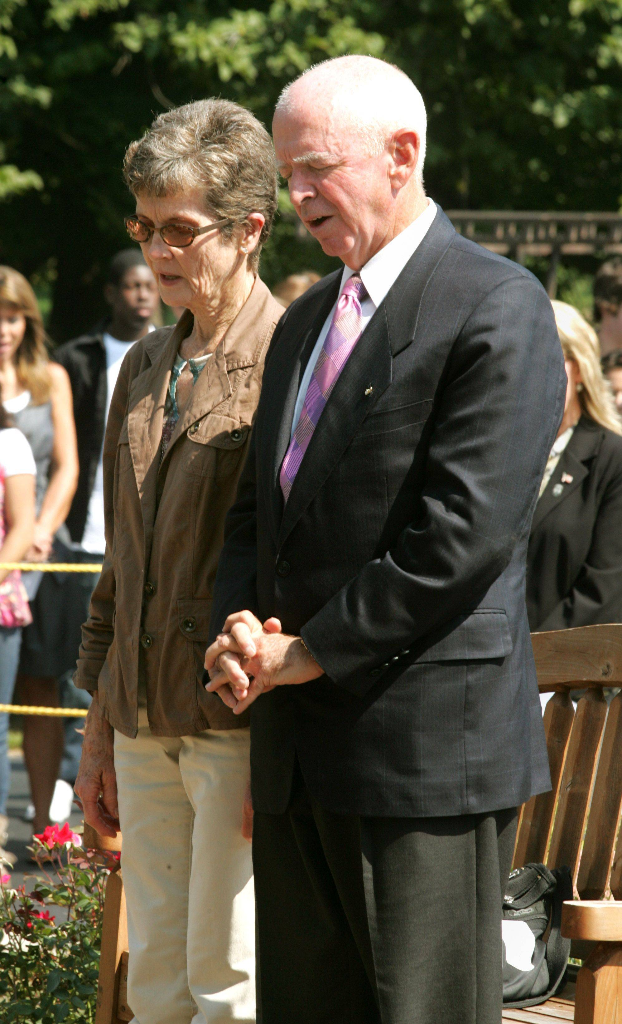 "David and Peggy Beamer pray and reflect upon their son's and others ""Flight of Valor"" aboard United Flight 93, during the Wheaton Academy Todd Beamer Memorial Plaque Dedication."