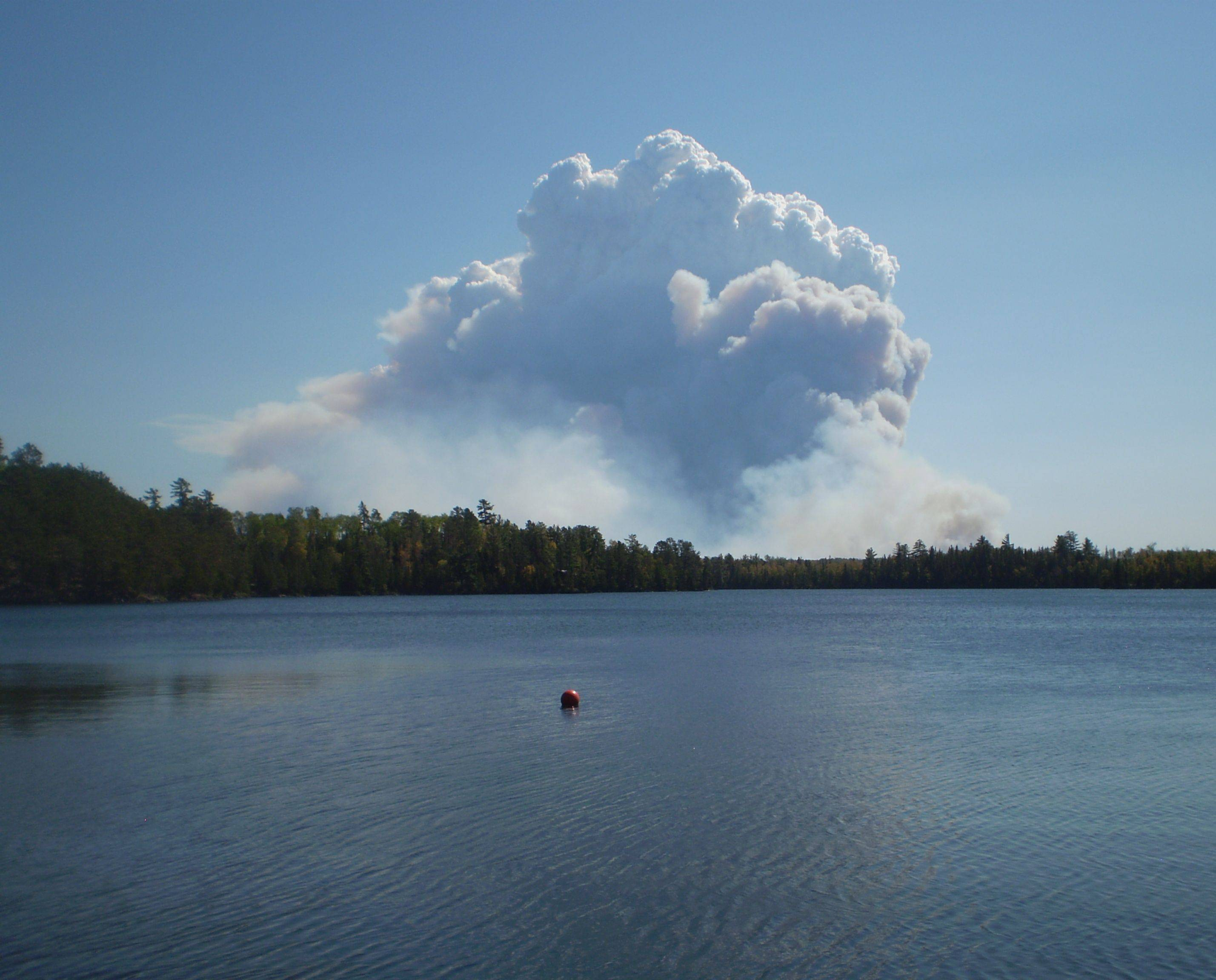 Smoke fills the sky from a fire outside the borders of the Boundary Waters Canoe Area near Ely, Minn., on Sunday. The Pagami Creek forest fire, estimated to cover as much as 60,000 acres in northeastern Minnesota, is blamed for a pall of smoke over the Chicago suburbs Tuesday.