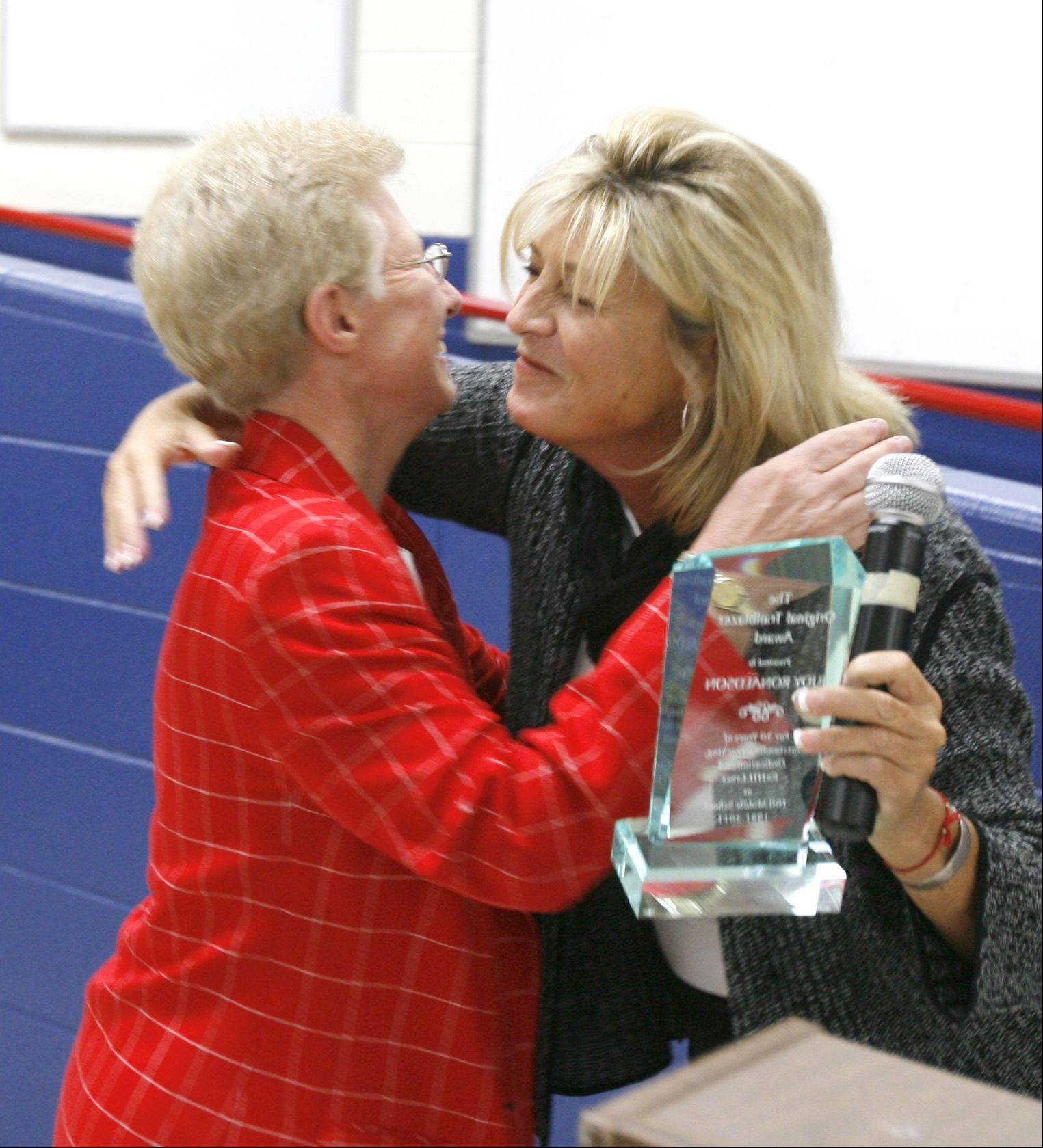 Teacher Judy Ronaldson, left, is acknowledged by Superintendent Kathy Birkett, right, for her service during the 30th Anniversary Celebration Breakfast at Thayer J. Hill Middle School in Naperville.