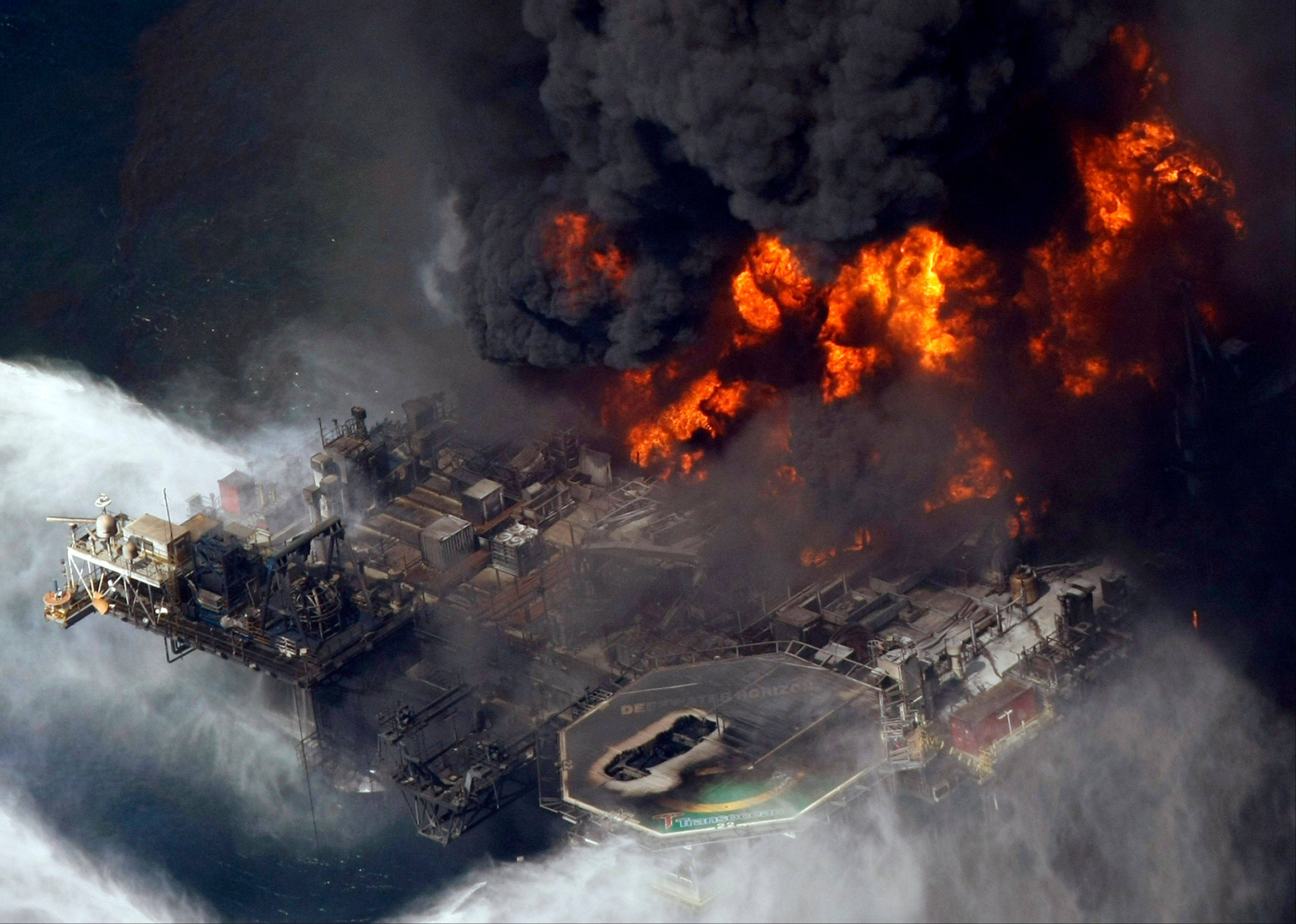 In this April 21, 2010, file photo taken in the Gulf of Mexico more than 50 miles southeast of Venice on Louisiana�s tip, the Deepwater Horizon oil rig is seen burning.