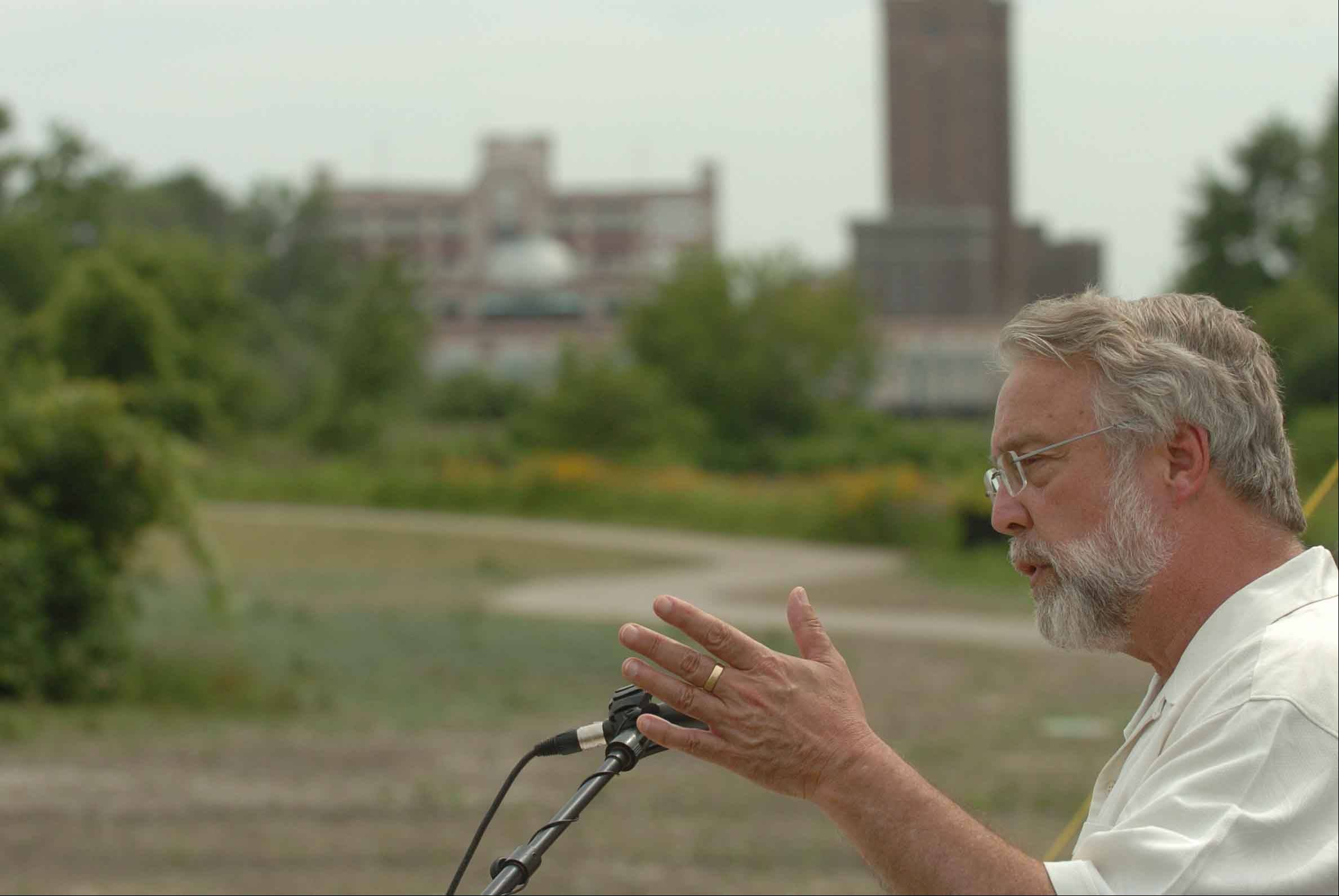 Aurora Mayor Tom Weisner speaks at the future site of RiverEdge Park, where hiring guidelines imposed by funding grants are being met.