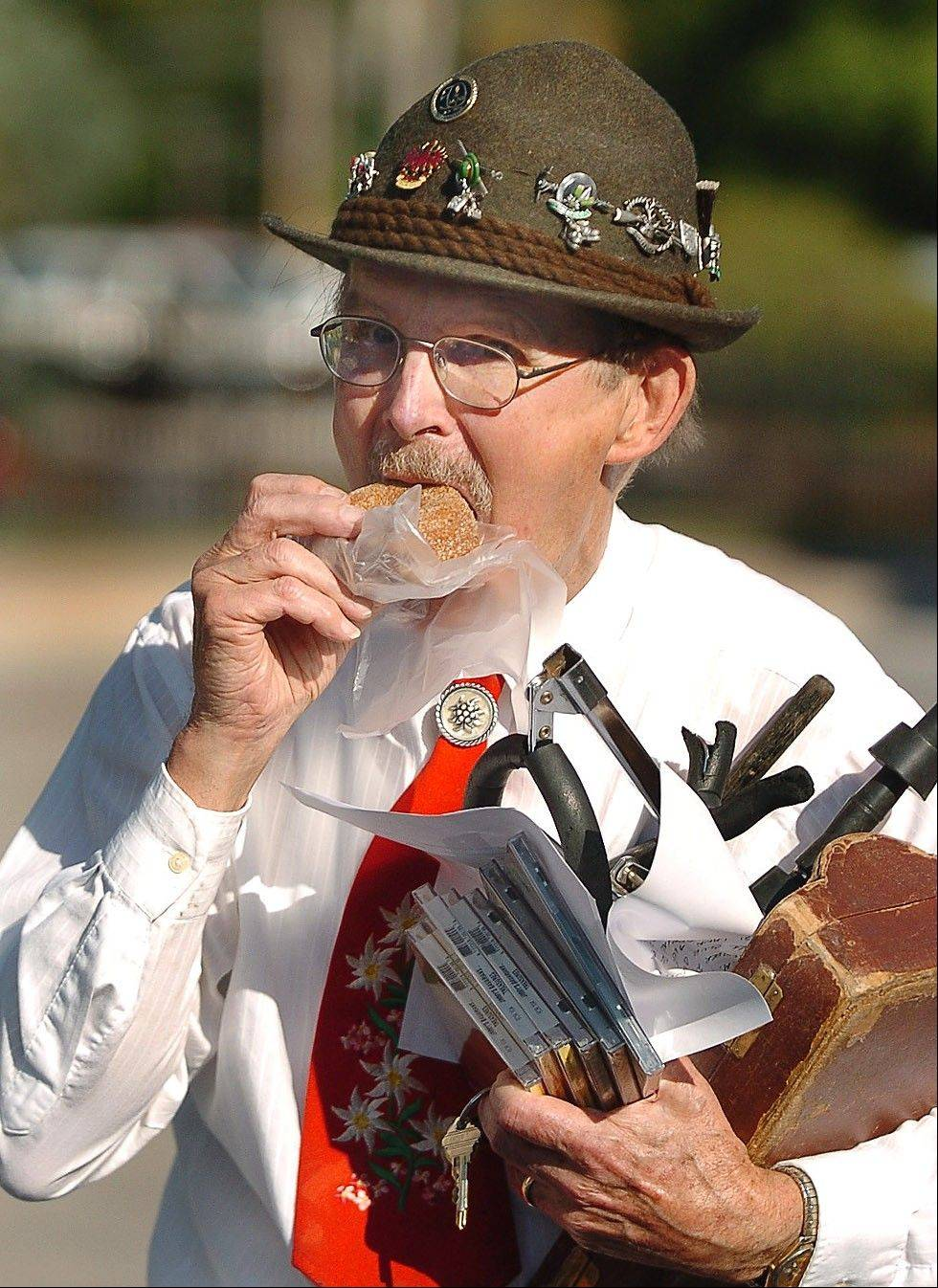 Jimmy Bestman, of the oompah band Jimmy's Bavarians, takes a break at last year's festival to try a cider spice doughnut. The band is back this year.