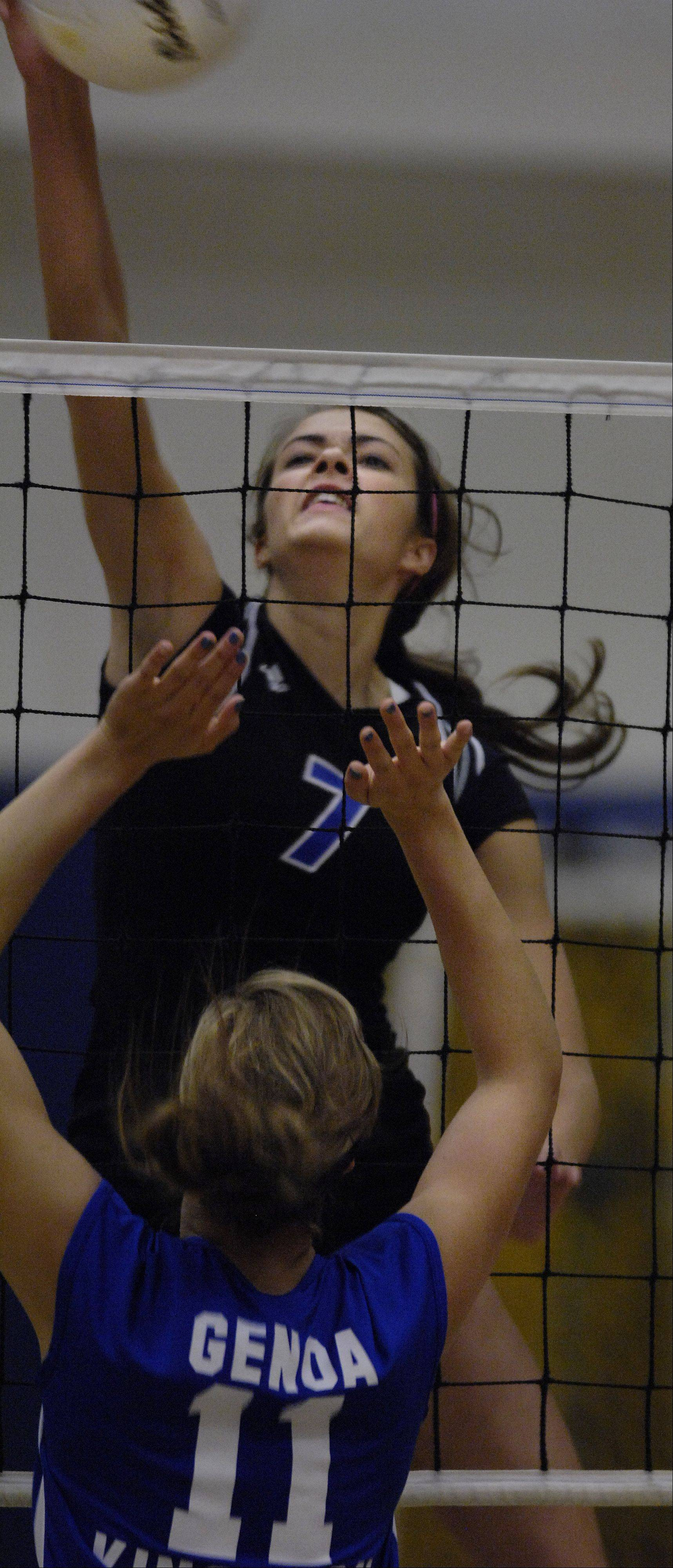 Burlington Central�s Hayley Brake goes above the defense of Genoa Kingston�s Tori Hensley Wednesday in Burlington.
