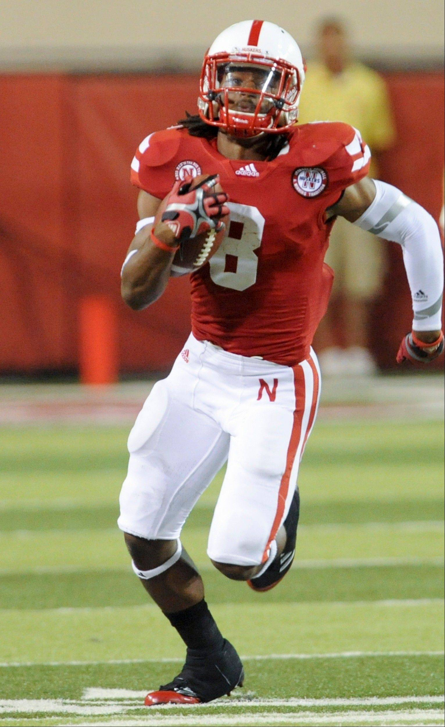Nebraska's Ameer Abdullah returns a kickoff 100 yards for a touchdown in the second half Saturday against Fresno State. He came to Nebraska as the least heralded of the three running backs in the 2011 recruiting class. No doubt, his Q rating has shot past that of those other backs, Braylon Heard and Aaron Green, since he returned a kickoff 100 yards for a touchdown to break open last week's 42-29 win over Fresno State.