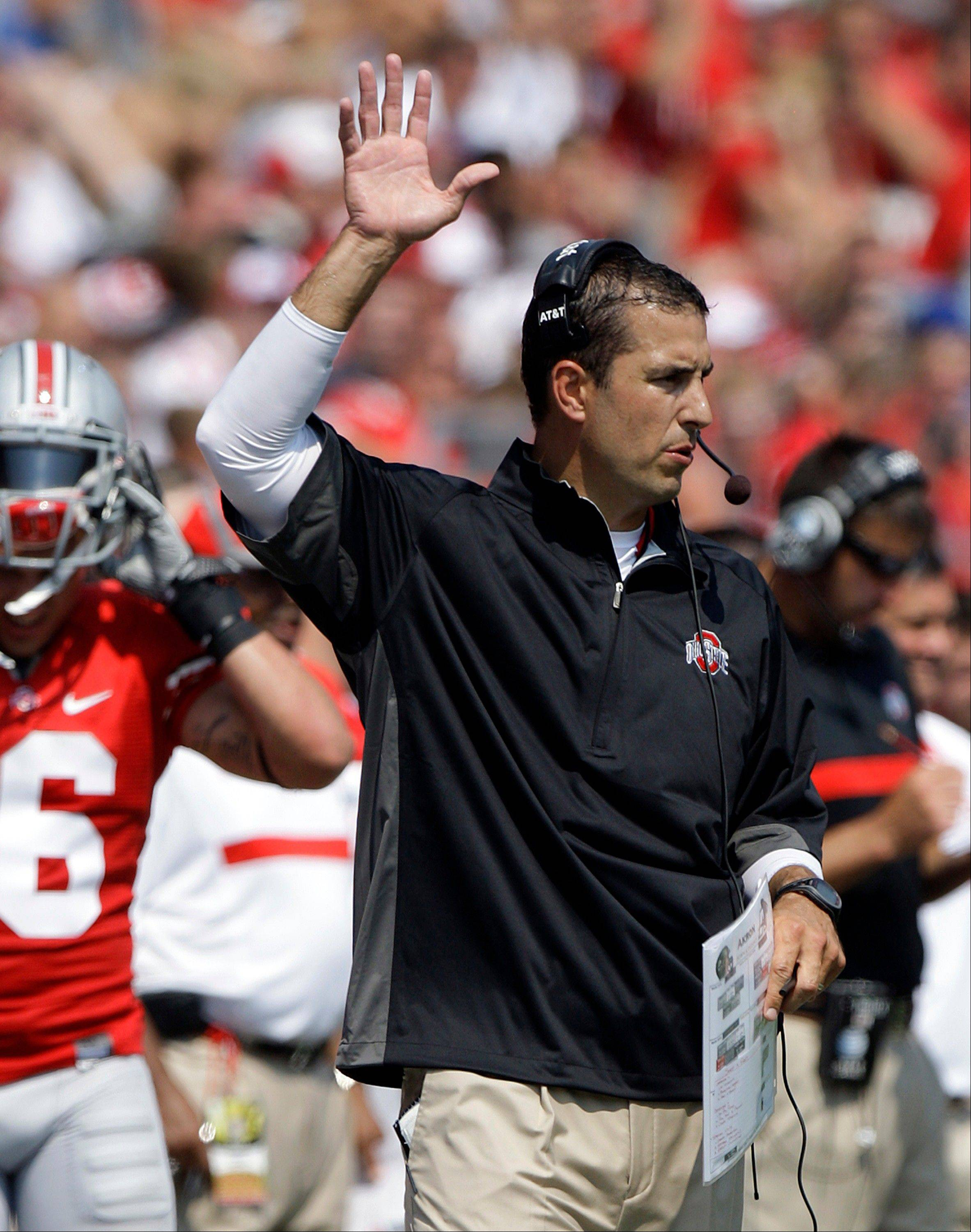 Ohio State�s Luke Fickell coaches against Akron earlier this season. An Ohio State booster says he�s responsible for giving cash to three players who were suspended for two games by the NCAA.