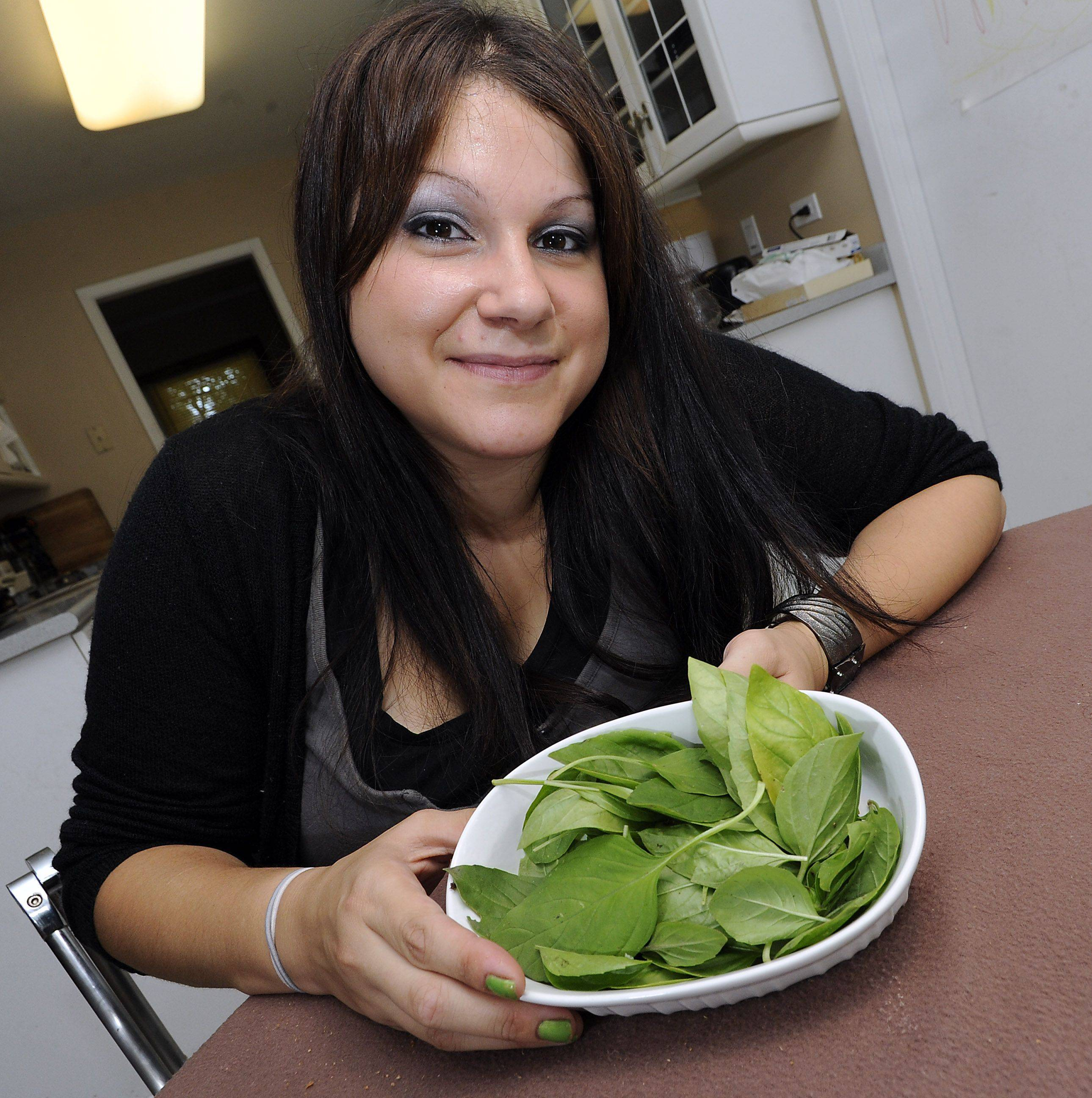 Mark Welsh/mwelsh@dailyherald.comJamie Andrade with her favorite ingredient, fresh basil leaves to go with her dishes.