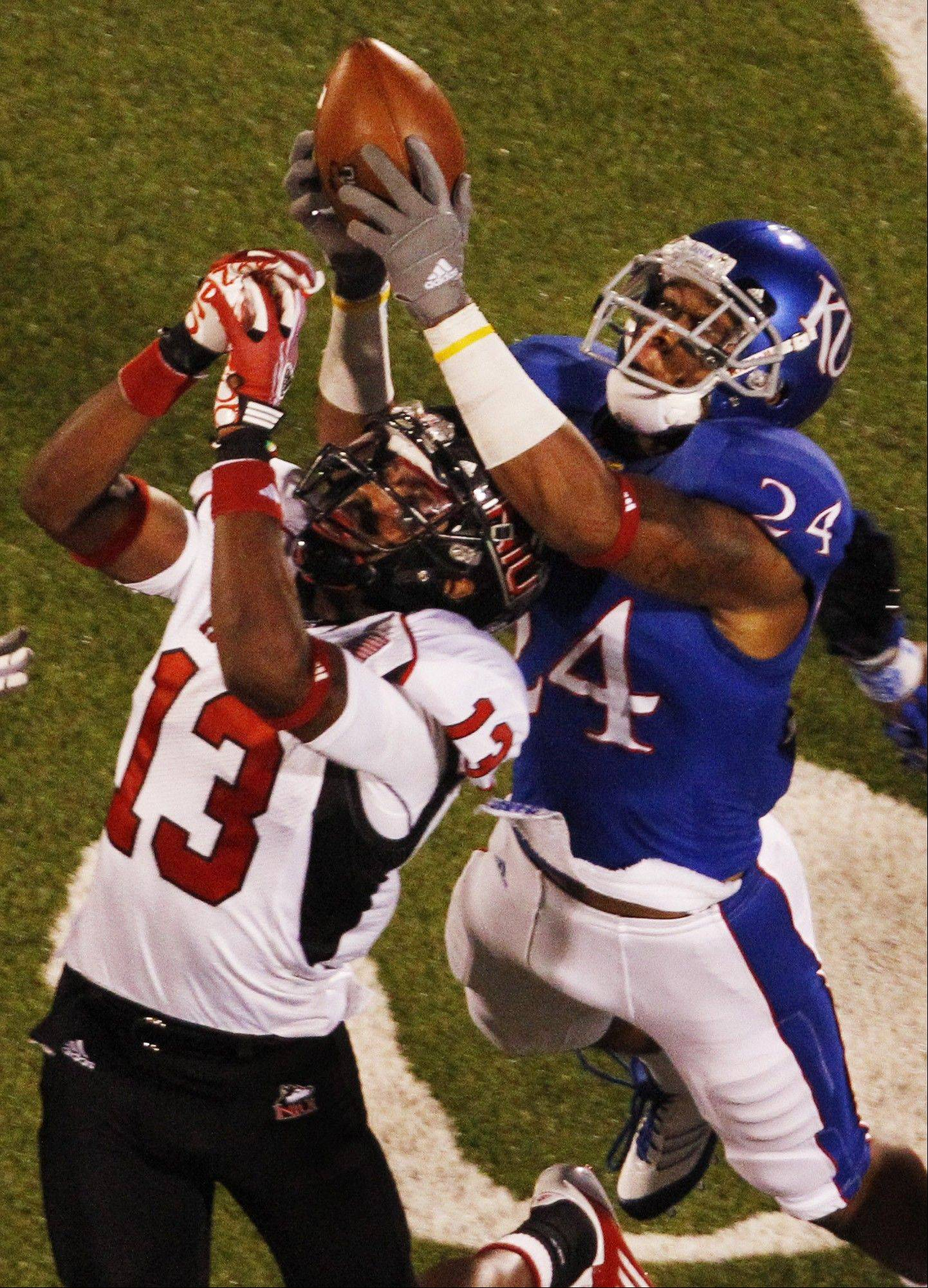 Kansas safety Bradley McDougald knocks the ball away from Northern Illinois wide receiver Anthony Johnson on the last play of the game Saturday night in Lawrence. Kansas defeated Northern Illinois 45-42.