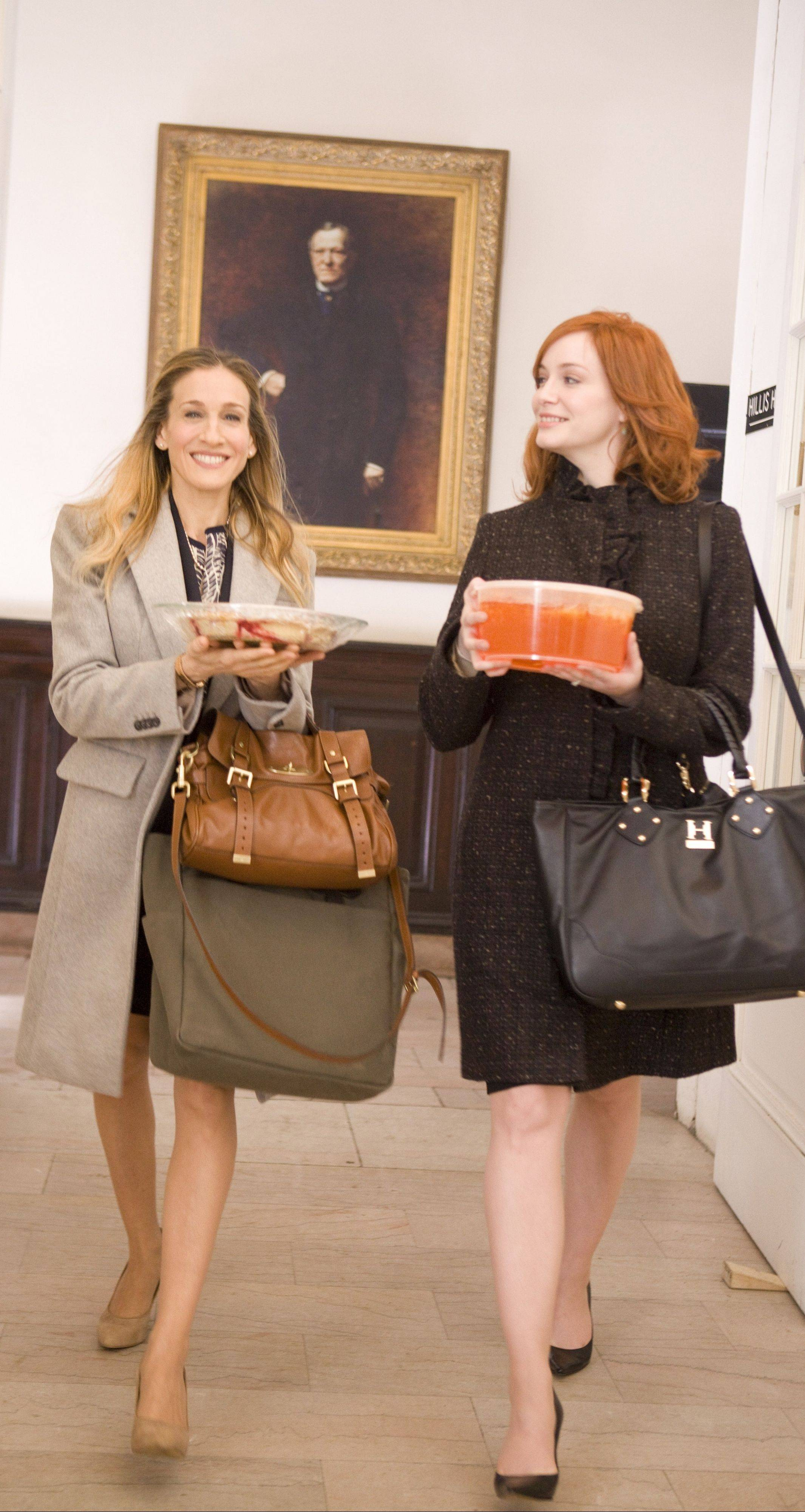 "Kate (Sarah Jessica Parker), left, and her pal Allison (Christina Hendricks) prepare for a school function in ""I Don't Know How She Does It."""