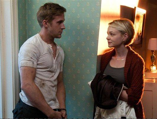 "The mysterious Driver (Ryan Gosling) gets involved with his neighbor (Carey Mulligan) in ""Drive."""