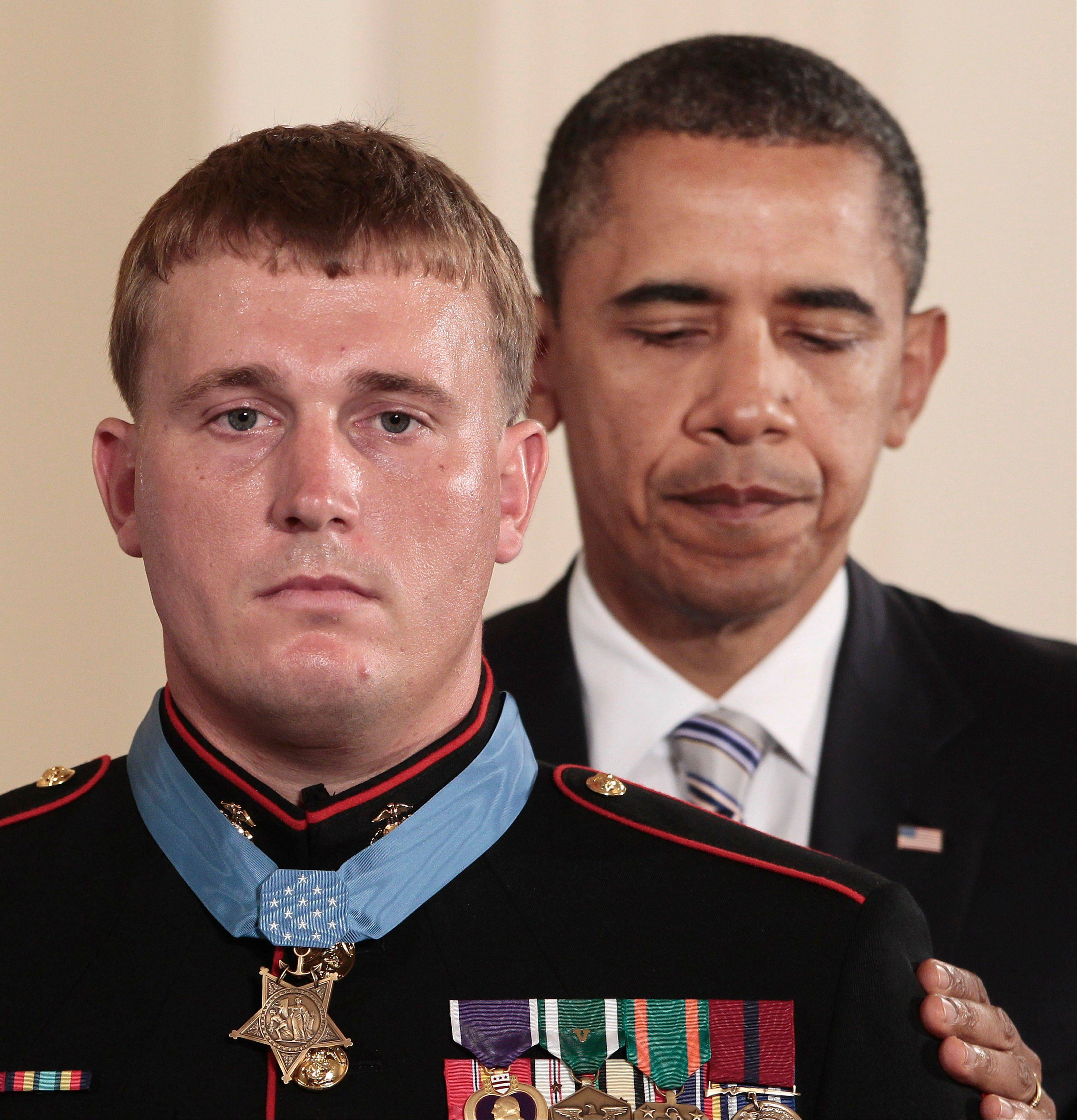 President Barack Obama awards the Medal of Honor on Thursday to former Marine Corps Cpl. Dakota Meyers, 23, from Greensburg, Ky., during a ceremony in the East Room of the White House in Washington.