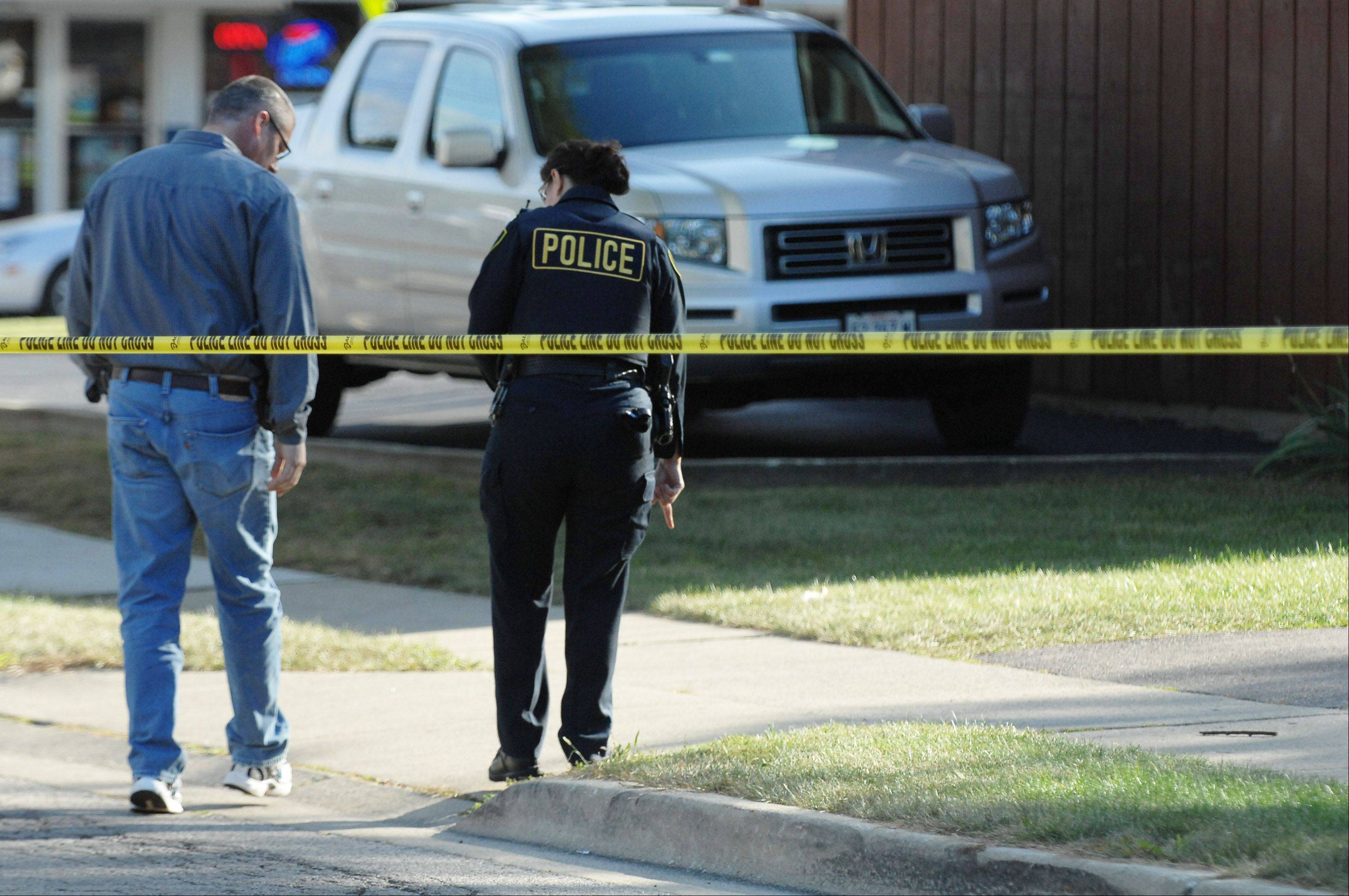Elgin police investigate a shooting on Wilcox Street south of Erie Street Thursday afternoon.