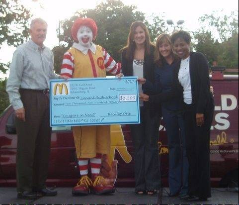 The McDonald�s Owners of Chicagoland and Northwest Indiana presented a check to representatives of Conant High School to support their Cougars in Need program, which helps students and their families who face financial difficulties. Pictured, from left, is Steve Reckley, local McDonald�s owner/operator; Ronald McDonald; Kim Wiley, college and career counselor; Paula Hill, student services department chairwoman; and Yvette Jones, college and career counselor.