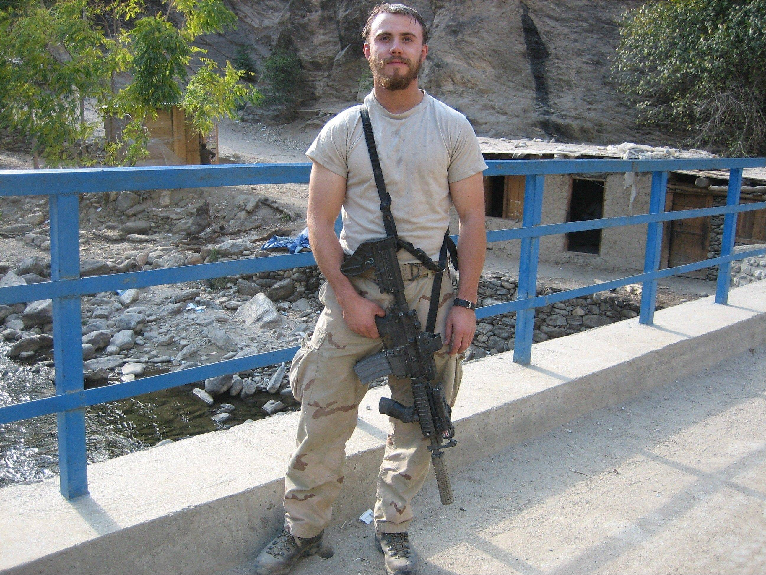 The commons area of Wheaton North High School will be renamed the Robert J. Miller Commons Area, after the Wheaton native, shown here in Afghanistan, who died in battle there in 2008. He was awarded the Medal of Honor last October.