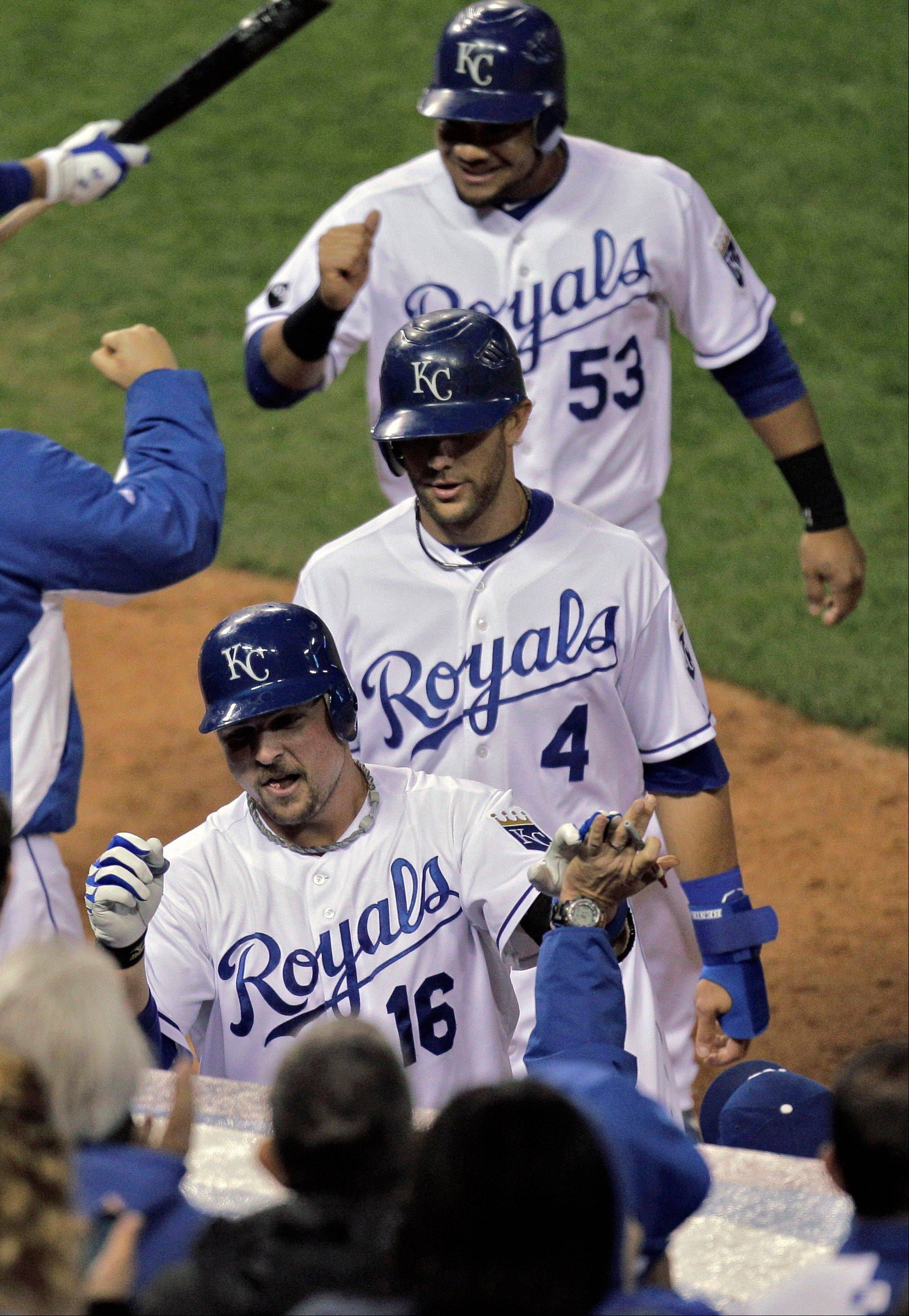 Kansas City�s Billy Butler (16) is followed into the dugout by Alex Gordon (4) and Melky Cabrera (53) after Butler hit a 3-run home run during the sixth inning Thursday night against the White Sox.