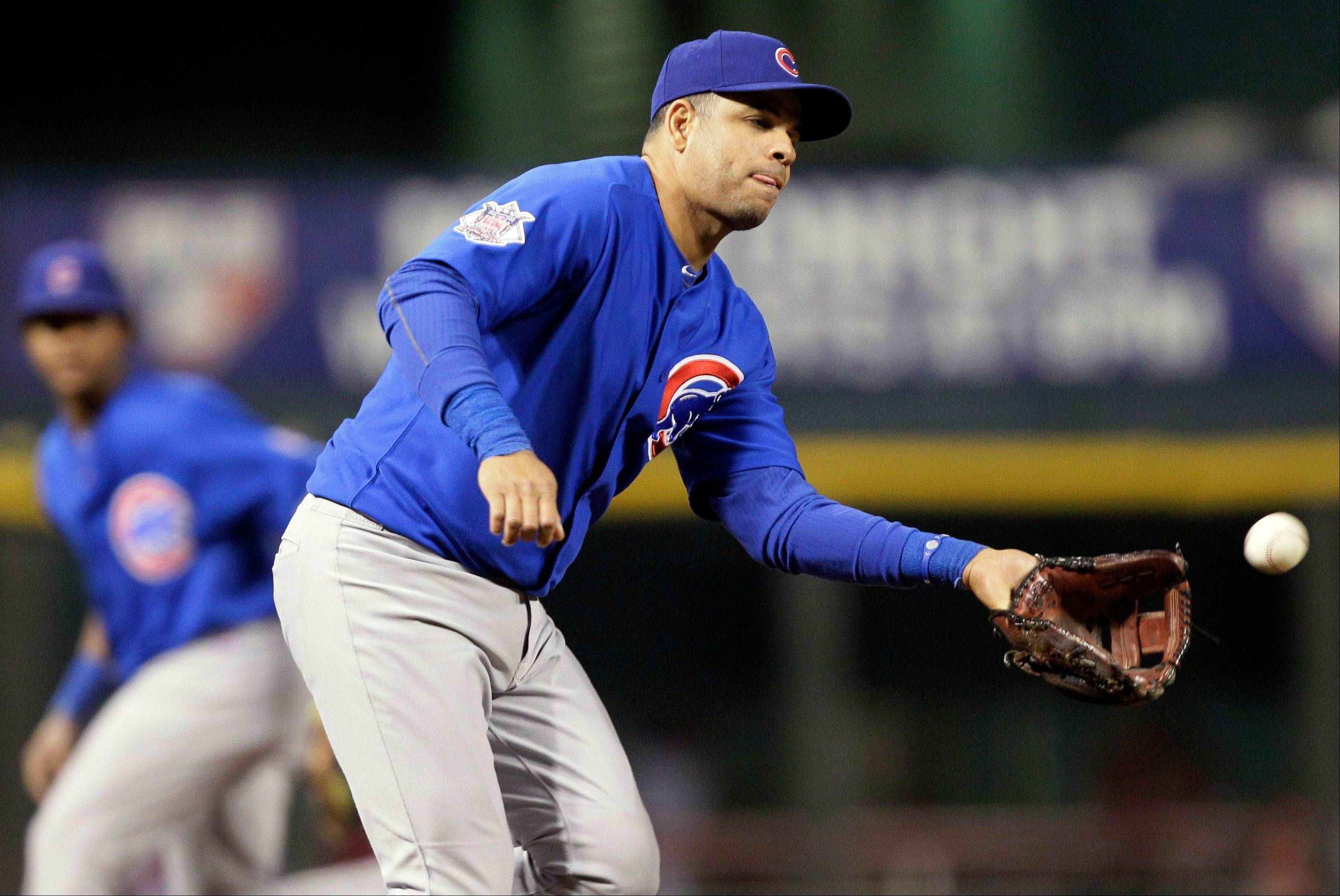 Cubs third baseman Aramis Ramirez fields a ground ball hit by Cincinnati Reds' Homer Bailey in the third inning Thursday night.