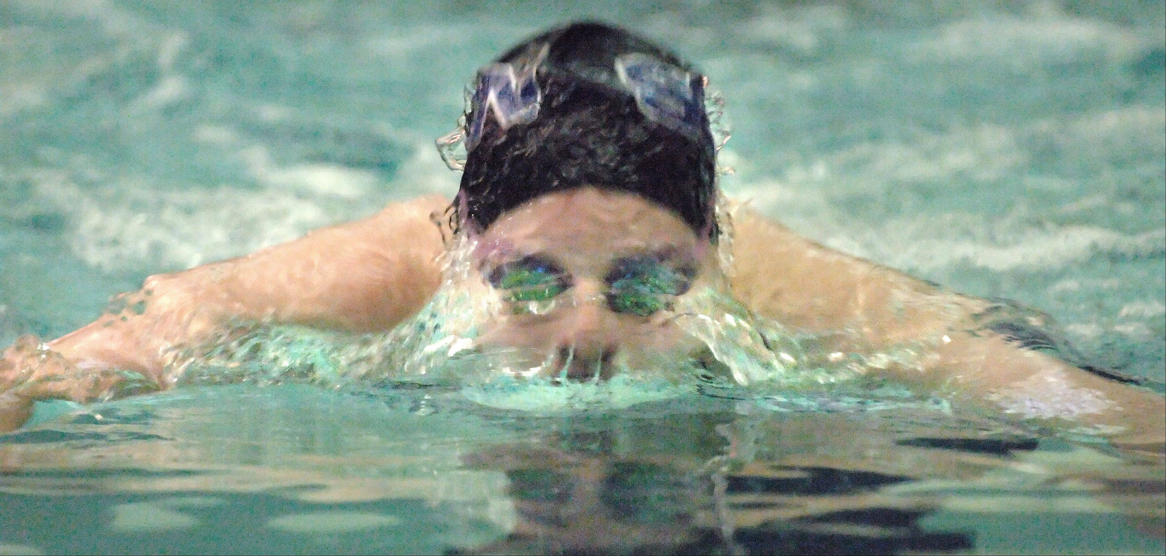 St. Charles North�s Meagan Popp, a freshman, emerges from the depths to win the 100 Yard Breaststroke against St. Charles East Thursday.