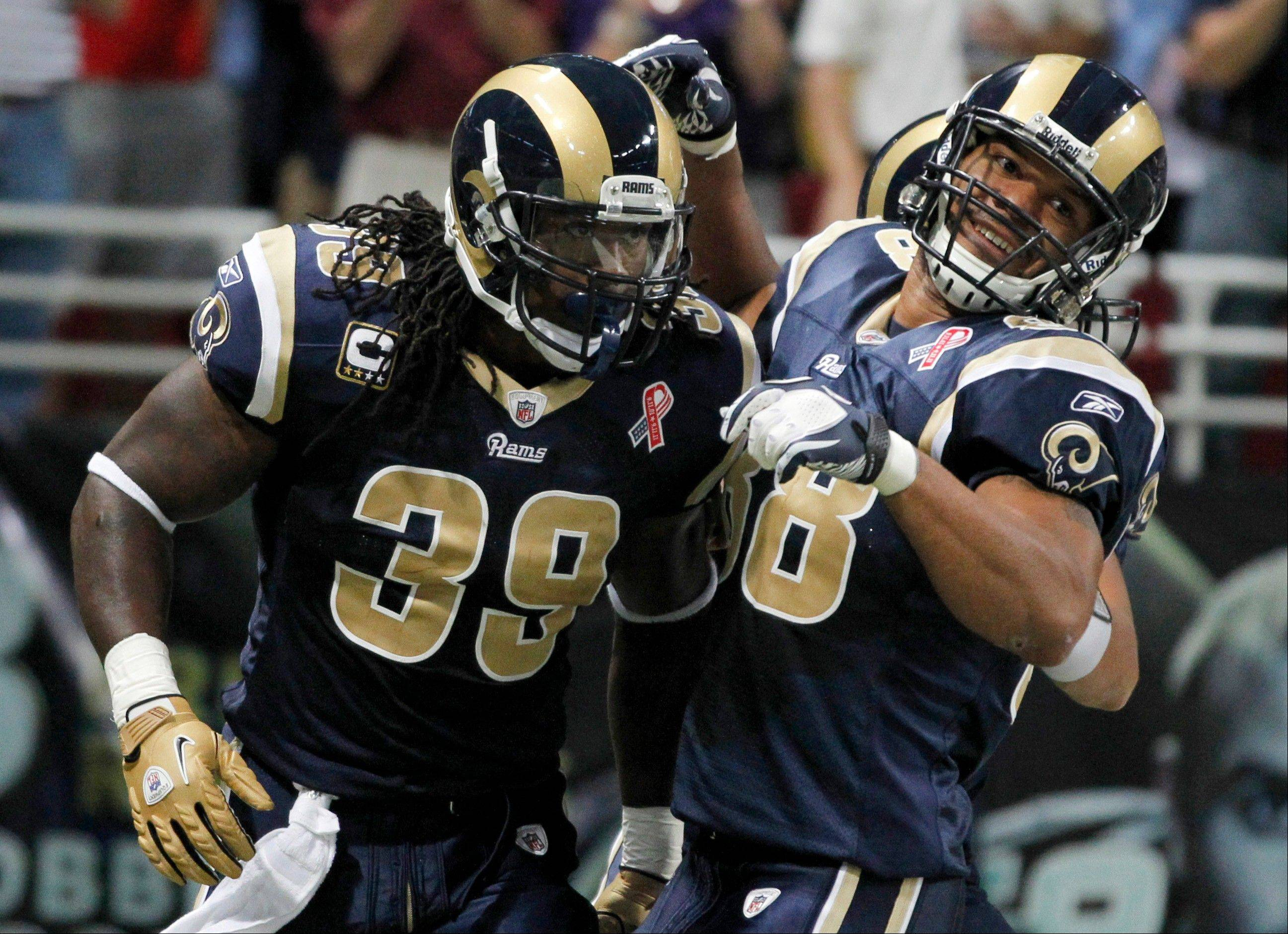 St. Louis Rams running back Steven Jackson, left, is congratulated by Lance Kendricks after running for a 47-yard touchdown during the first quarter Sunday.