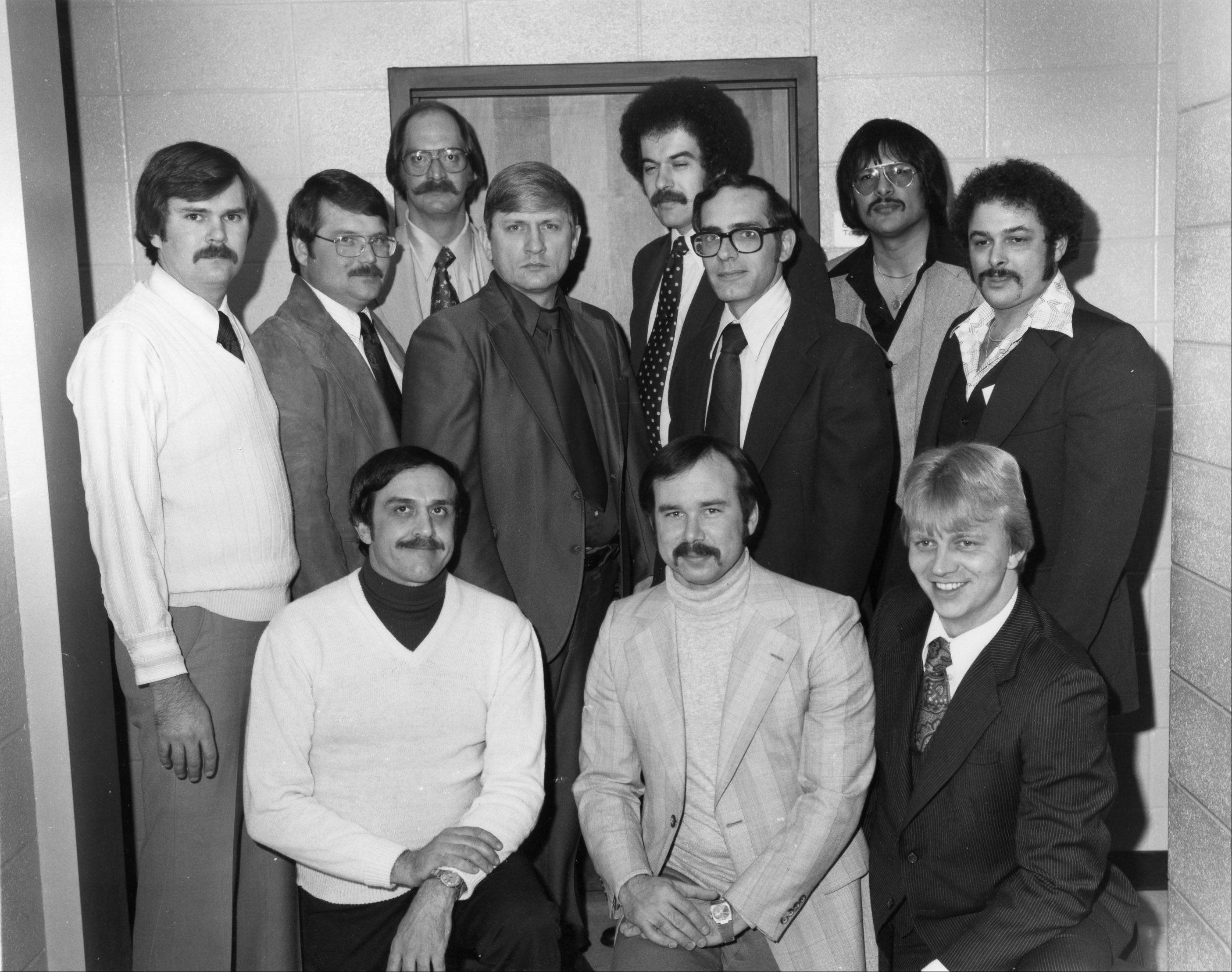 The team of Des Plaines Police investigators who broke the case of notorious serial killer John Wayne Gacy, Jr., all of whom are no longer with the department and some are deceased. In the front row from left are, the late detective James Pickle, detective James Ryan, officer Michael Albrecht; back row from left, officer David Hachmeister, the late detective James Kautz, officer Ronald Robinson, Sgt. Joseph Kozenczak, Sgt. Walter Lang, the late detective Ronald Adams, detective Rafael Tovar, and officer Robert Schultz.