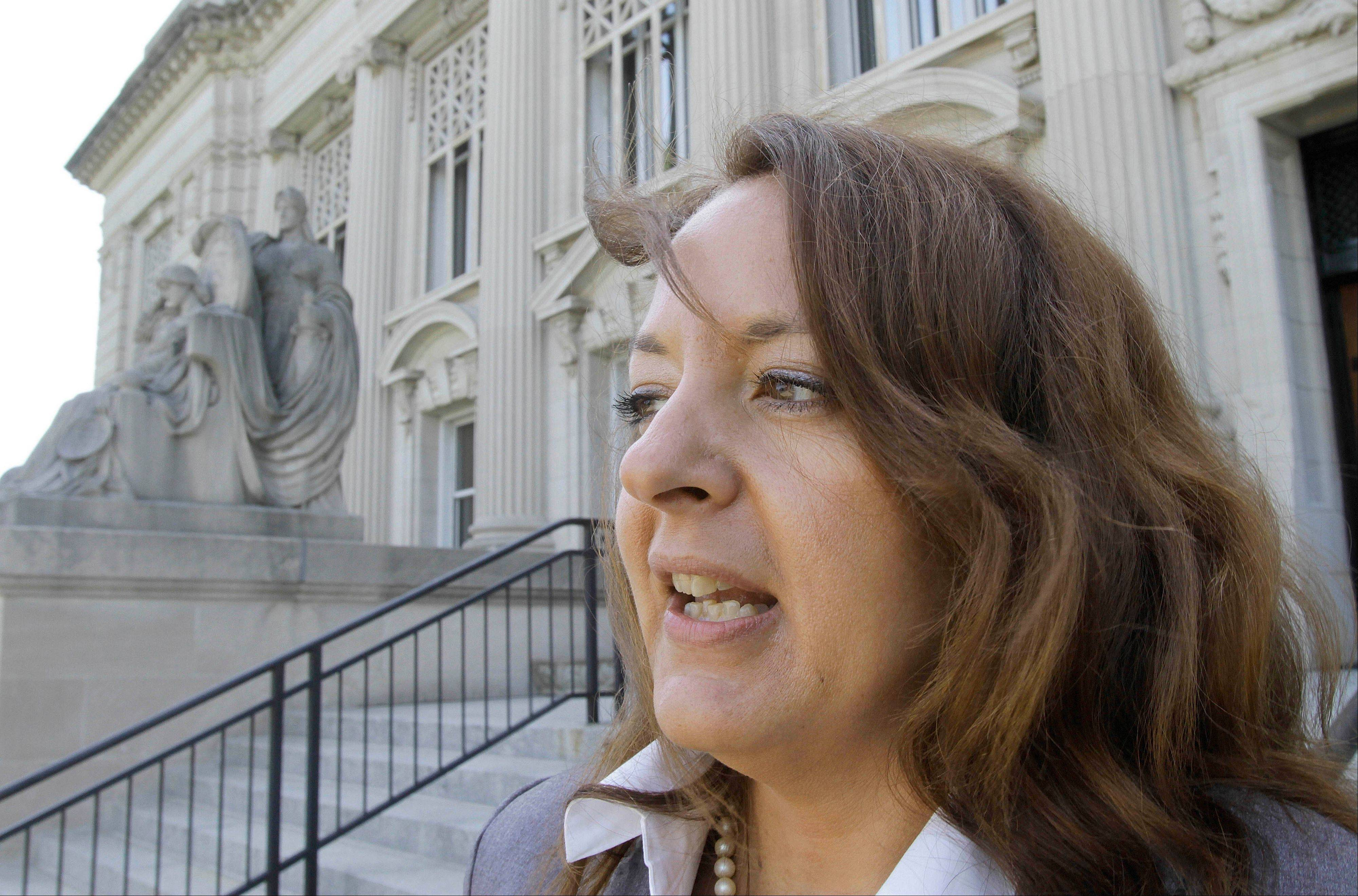 "Heidi Lambros, attorney for Stanley Wrice, speaks with the media outside the Illinois Supreme Court building Thursday in Springfield. ""This court should not tolerate the torture of its citizens within its walls,"" Lambros said during her oral argument."