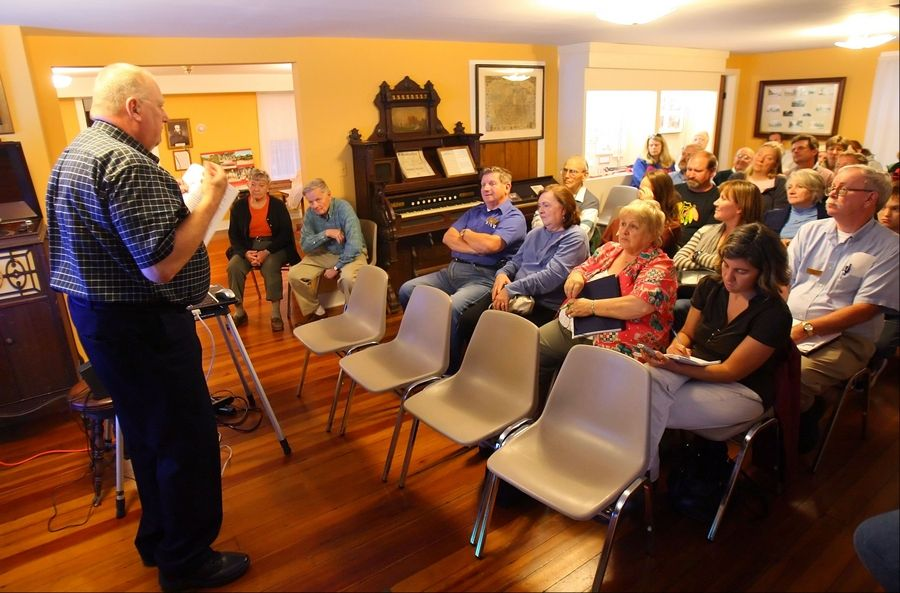 Tony Olszewski of the McHenry County Paranormal Research Group presented findings from the group's investigation of the Mother Rudd Home in Gurnee on Wednesday night. The group believes there is an unusual spiritual presence in the 19th-century home.