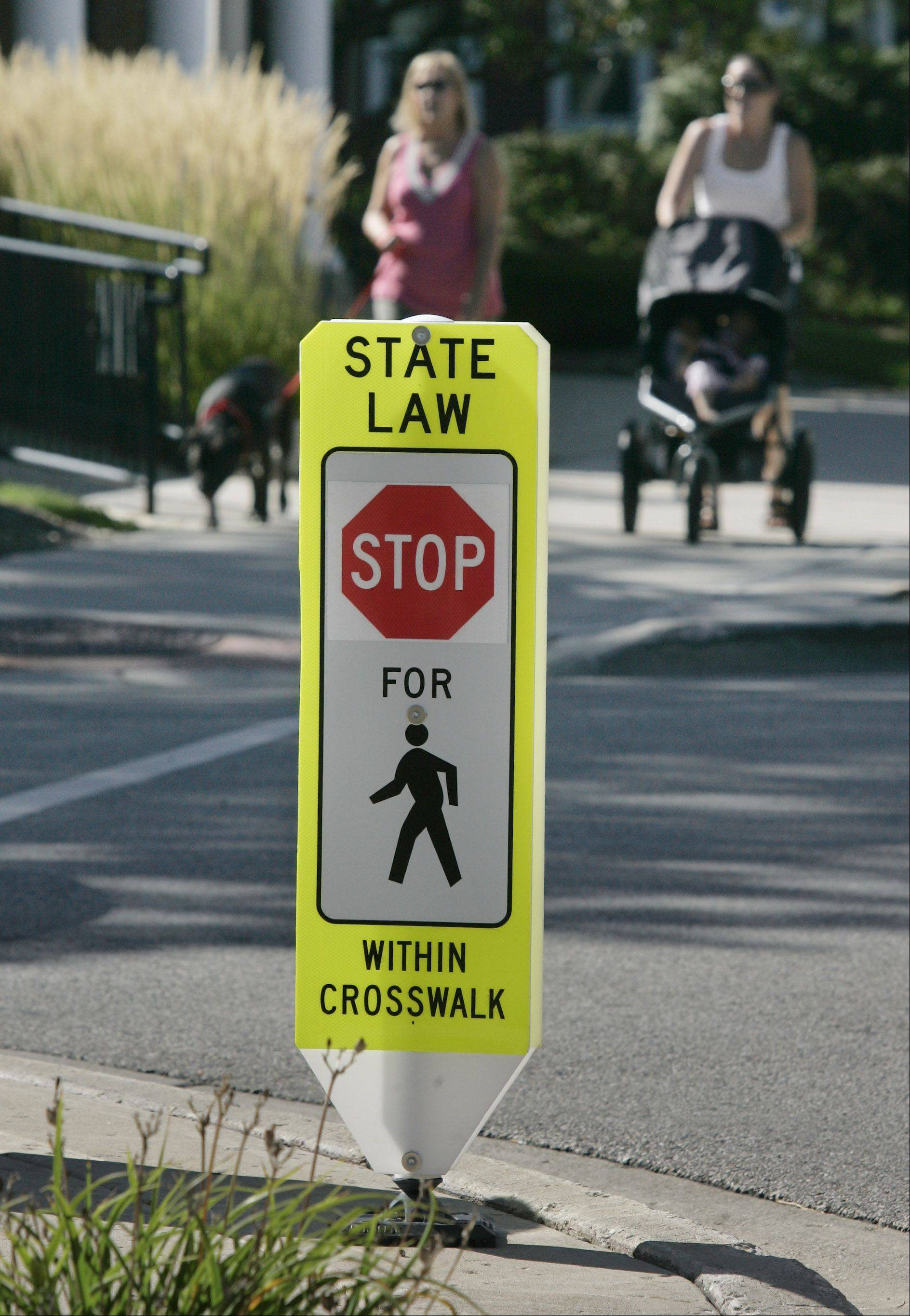 Drivers are now informed to stop -- not just yield -- for pedestrians on Main Street in downtown Wauconda. The sign reflects the state's stricter crosswalk law enacted a little more than a year ago.