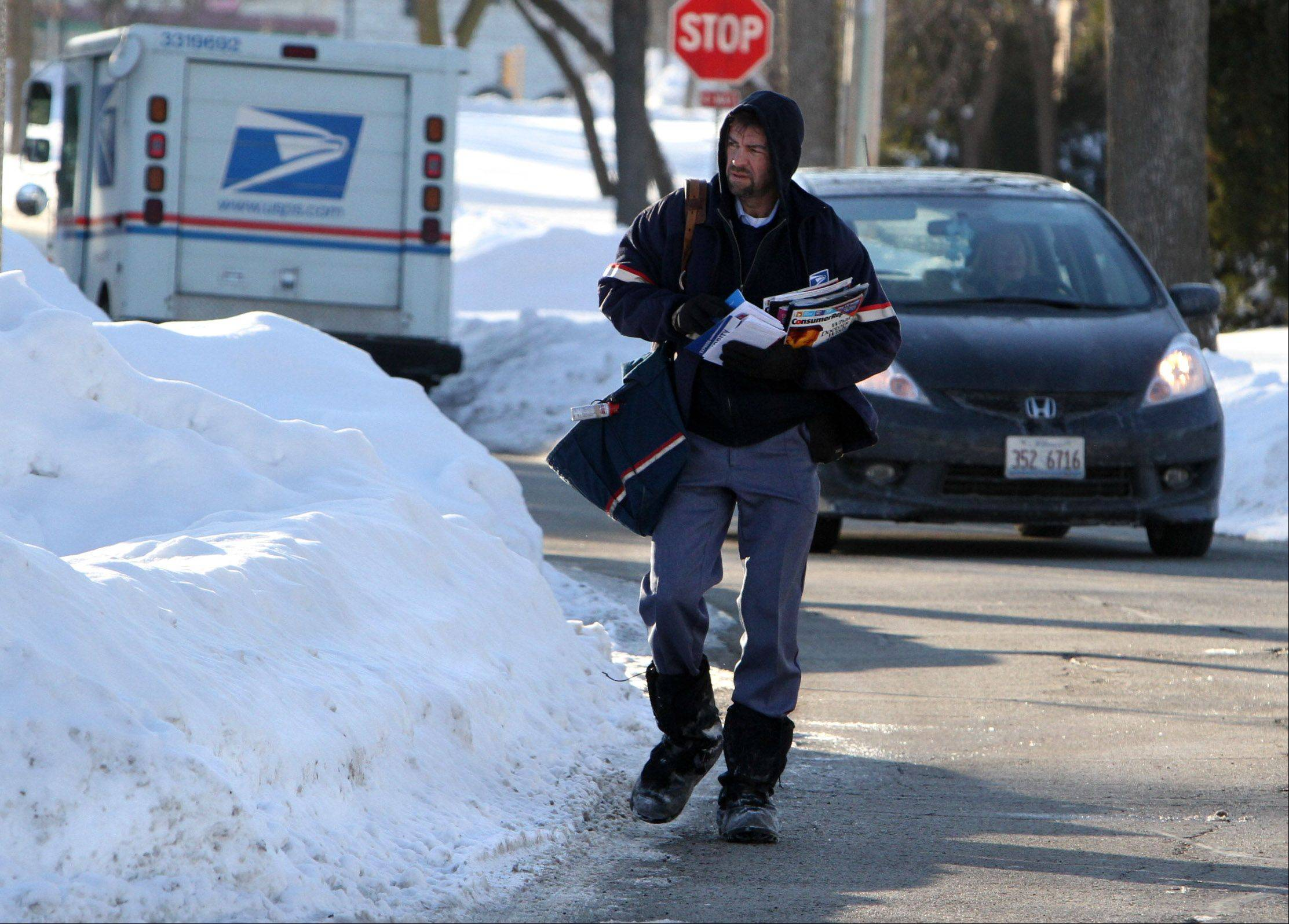 Nobody envies the letter carrier on days such as this one.