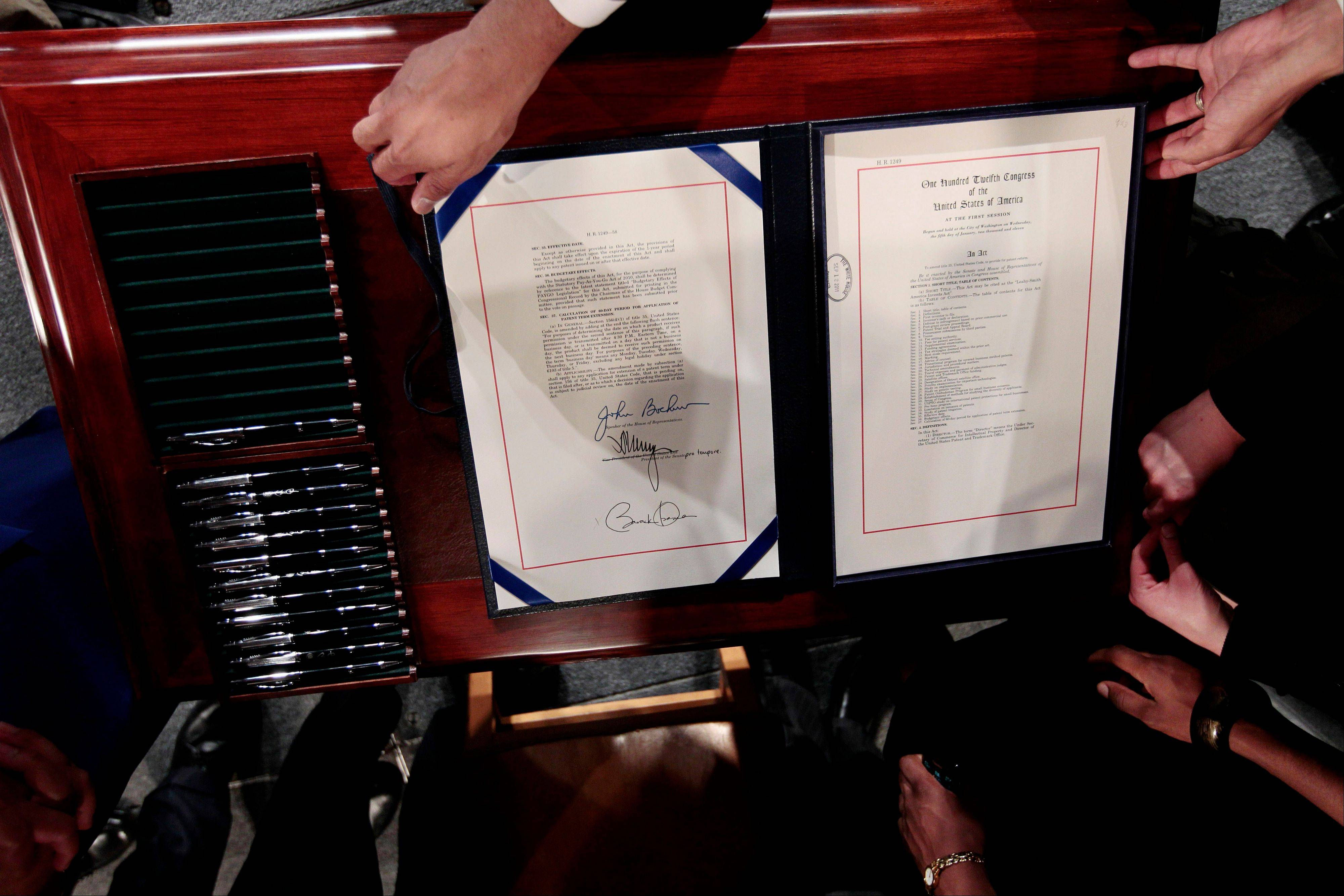 The American Invents Act is displayed Friday after President Barack Obama signed it into law.