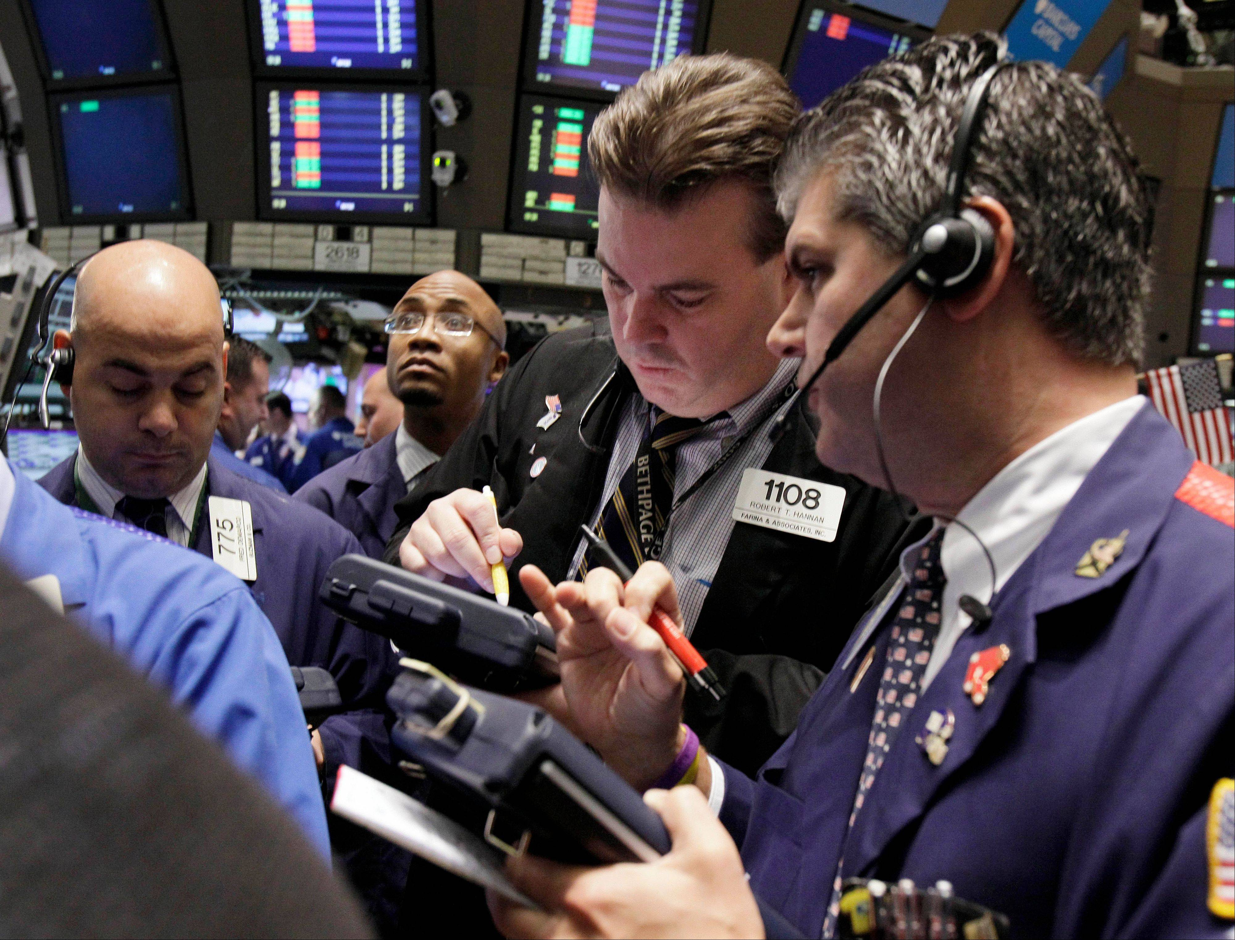 U.S. stocks alternated between gains and losses Friday after European finance ministers pushed back a decision about how to solve the region�s debt crisis.