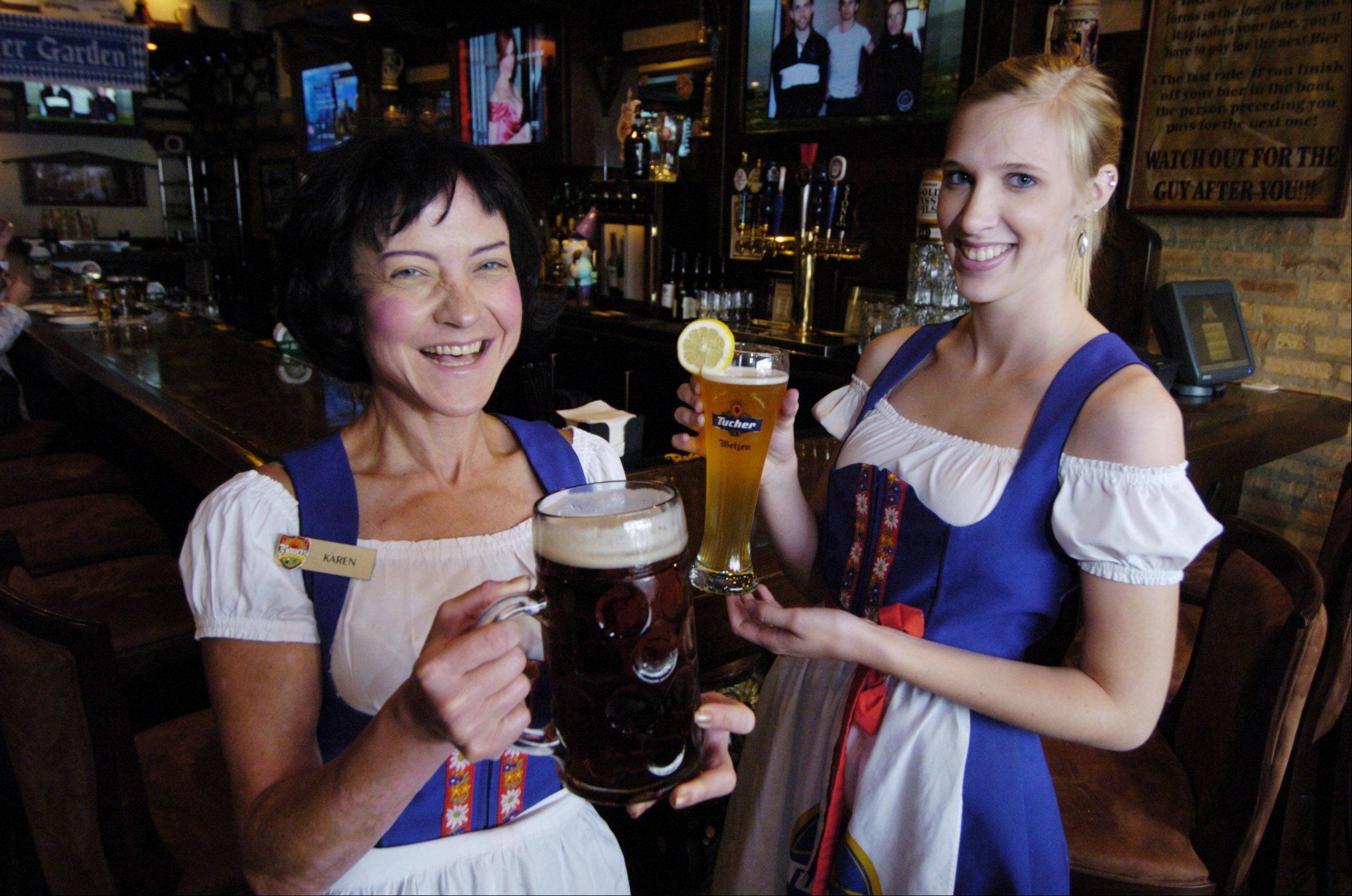 Karen Culver, left, and Alexandria Cook serve up a variety of brews at Bauer's Brauhaus in Palatine.