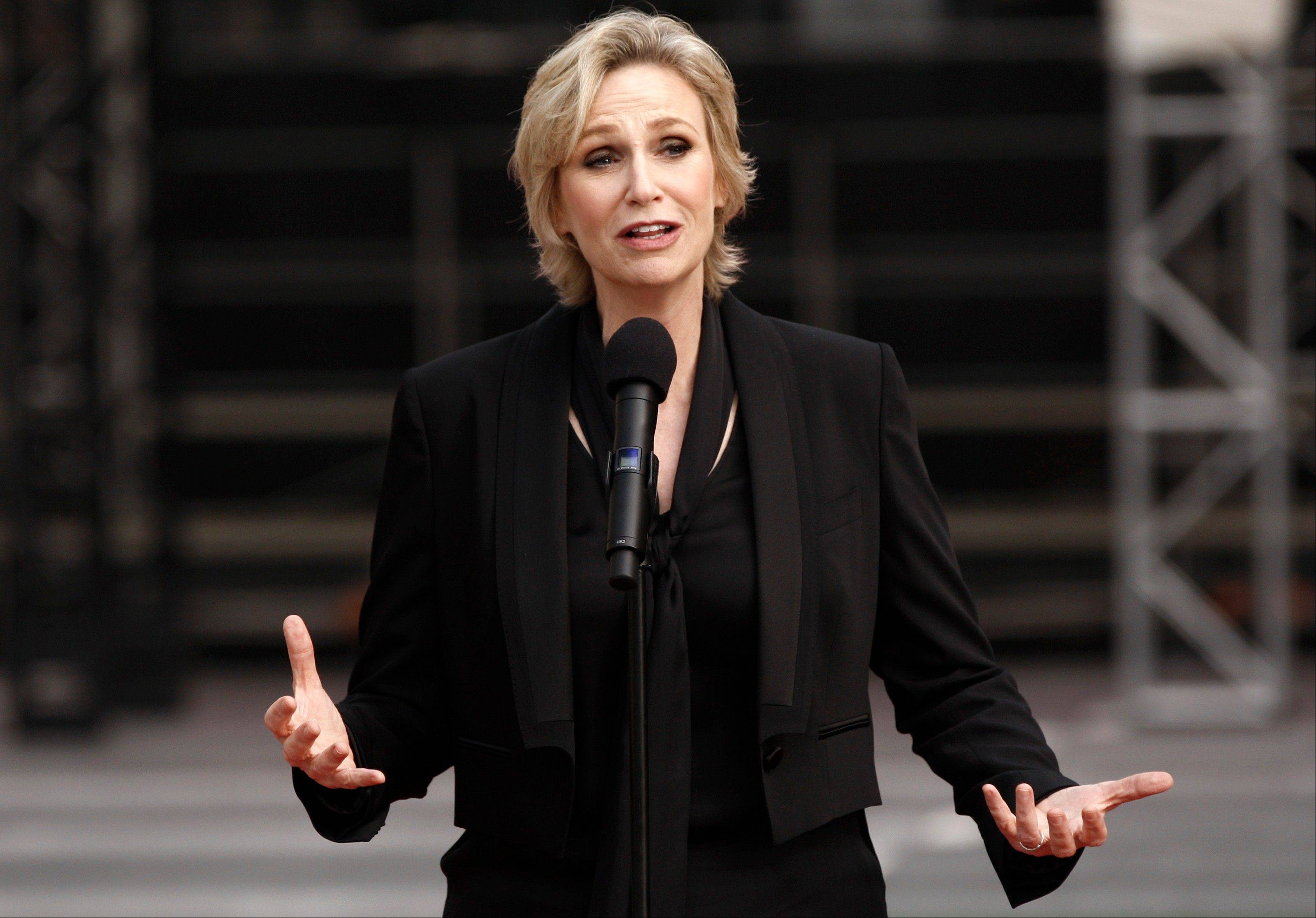 Jane Lynch speaks before the rollout of the red carpet for the 63rd Primetime Emmy Awards in Los Angeles on Wednesday. Lynch is hosting the Emmy Awards, which take place Sunday, Sept. 18, in Los Angeles.