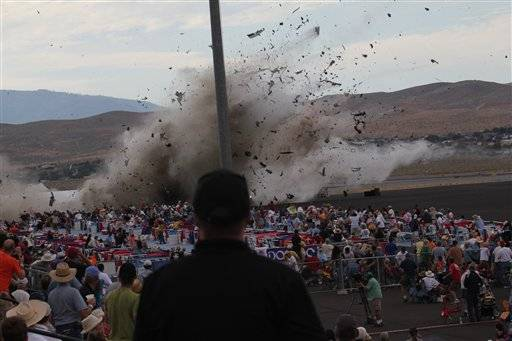A P-51 Mustang airplane crashes into the edge of the grandstands at the Reno Air show Sept. 16 in Reno Nevada. The World War II-era fighter plane flown by a veteran Hollywood stunt pilot Jimmy Leeward plunged Friday into the edge of the grandstands during the popular air race creating a horrific scene strewn with smoking debris.