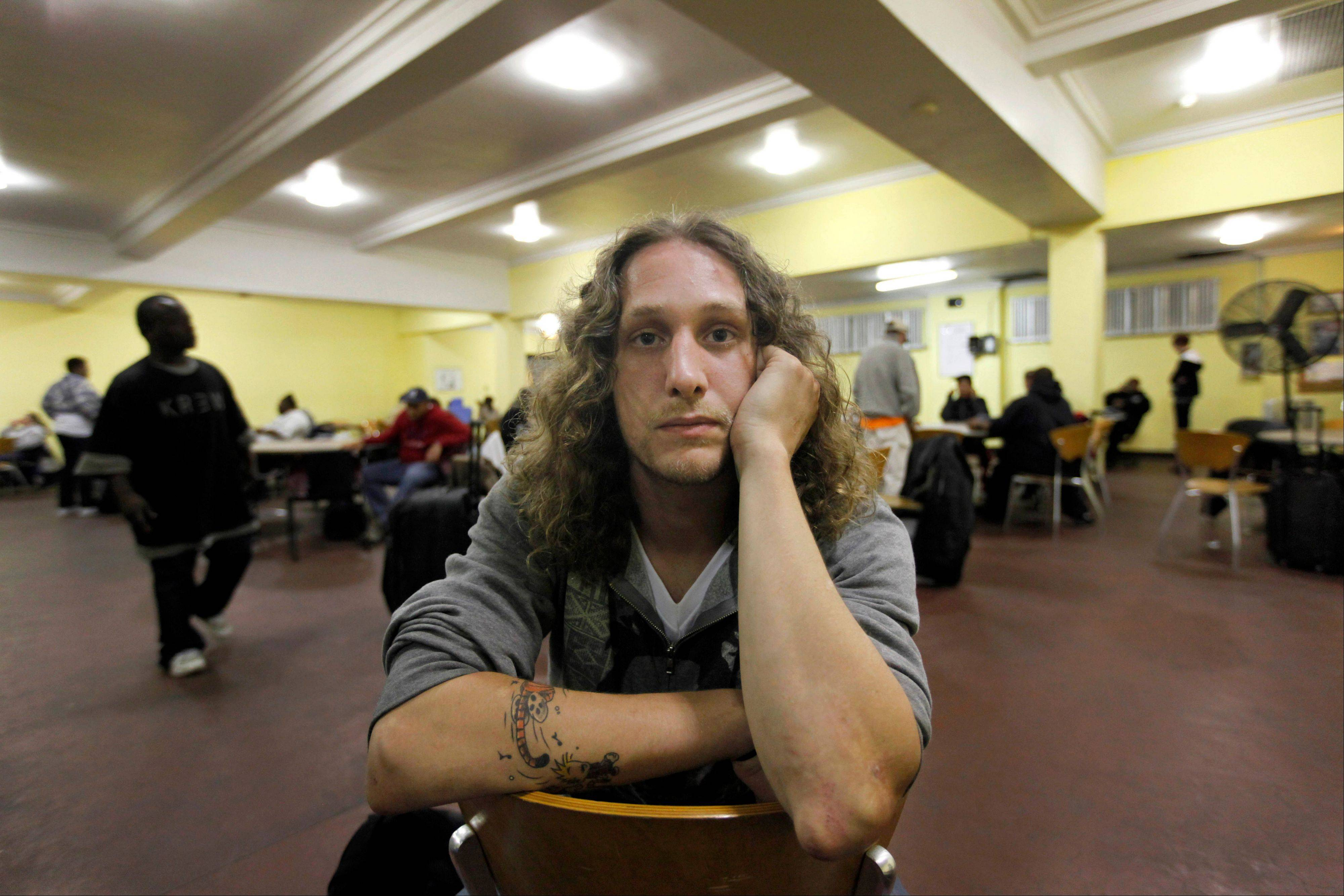 Colin Cook, 26, poses for a portrait at the multipurpose room of the REST Shelter in Chicago where he will be sleeping for two nights before finally getting his own place.