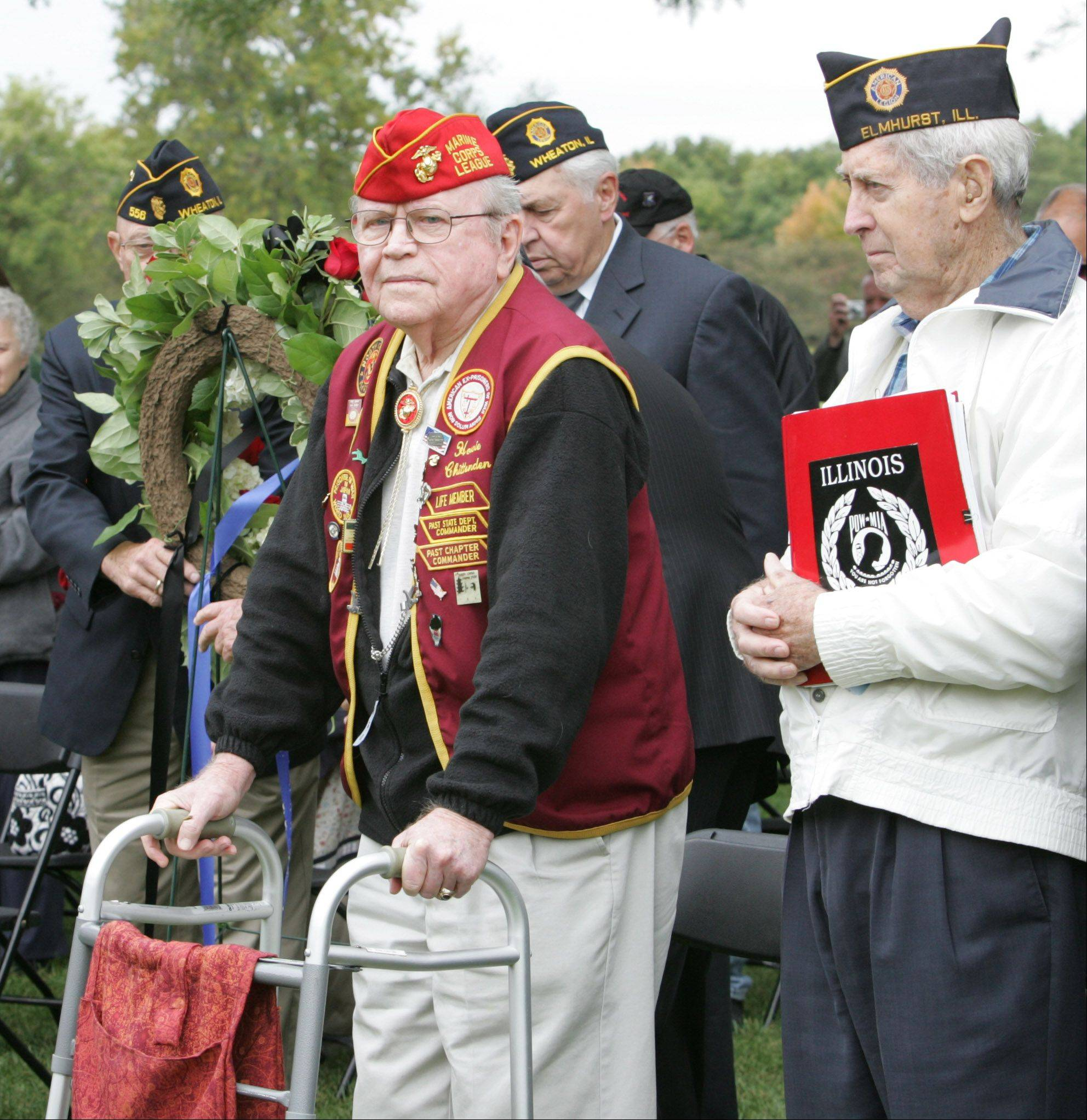 "Wheaton native William Howard ""Howie"" Chittenden, 92, left, was the keynote speaker in a ceremony to observe National POW/MIA Recognition Day at Cantigny Park in Wheaton. On the right is Leonard Prescott from American Legion Post 187 in Elmhurst."