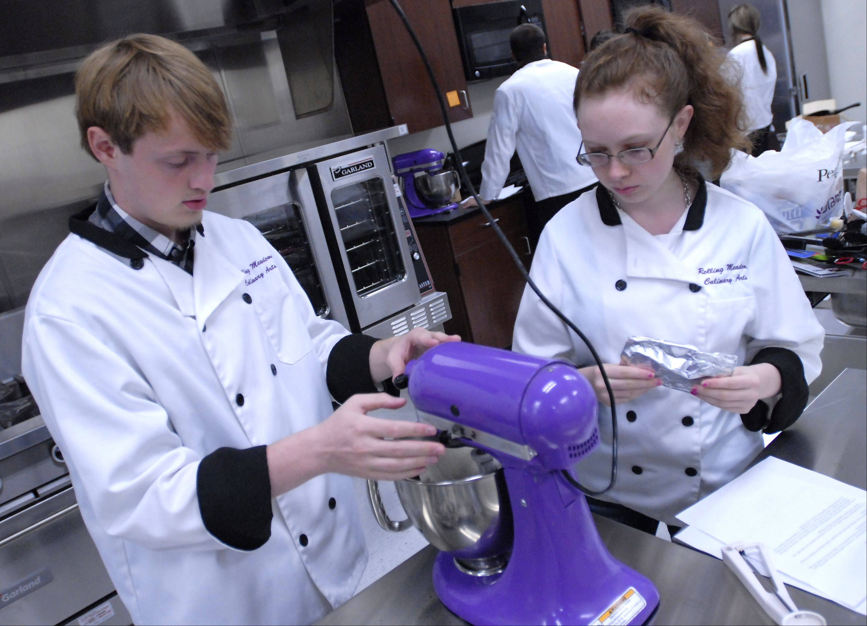 Jared Manwell, a senior at Elk Grove High School, and Haley Junius, a senior at Prospect High School, are both Culinary Arts 2 students. They are preparing Oreo truffles in the new professional kitchen for students at Rolling Meadows High School.