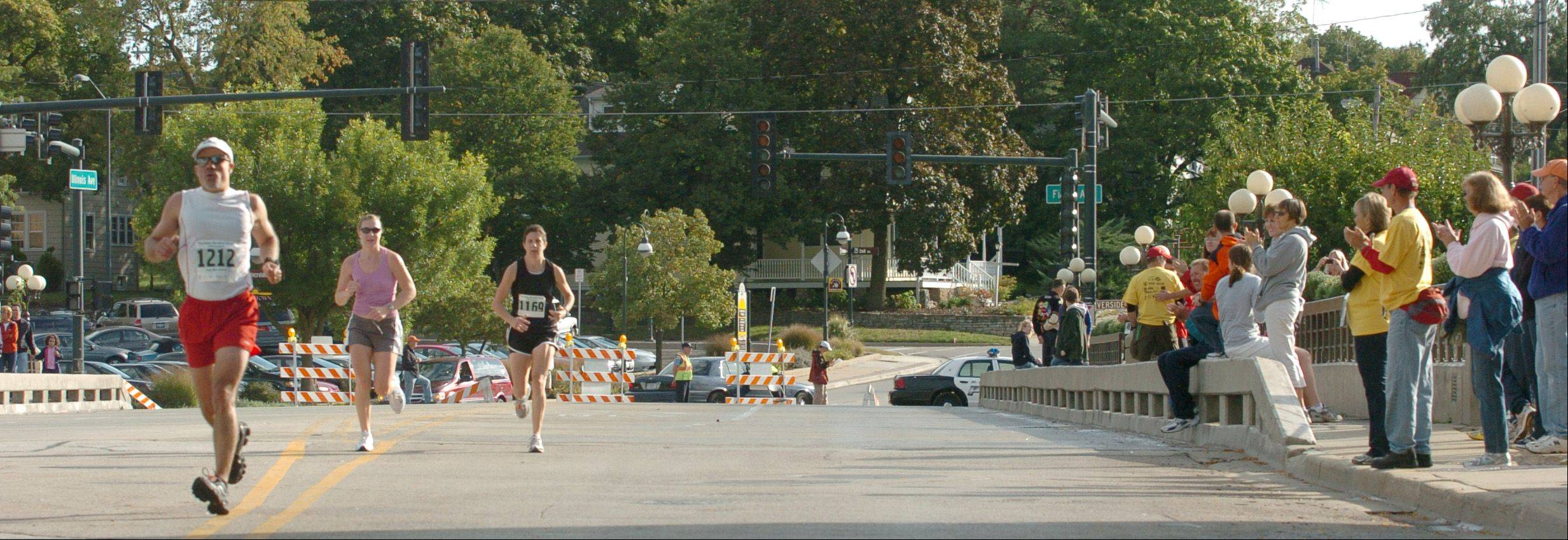 The top 50 runners slowly start to trickle in at the Dick Pond Fox Valley Marathon in St. Charles last September 2010. More than 1,000 participants generally followed a path along the Fox River through several towns.