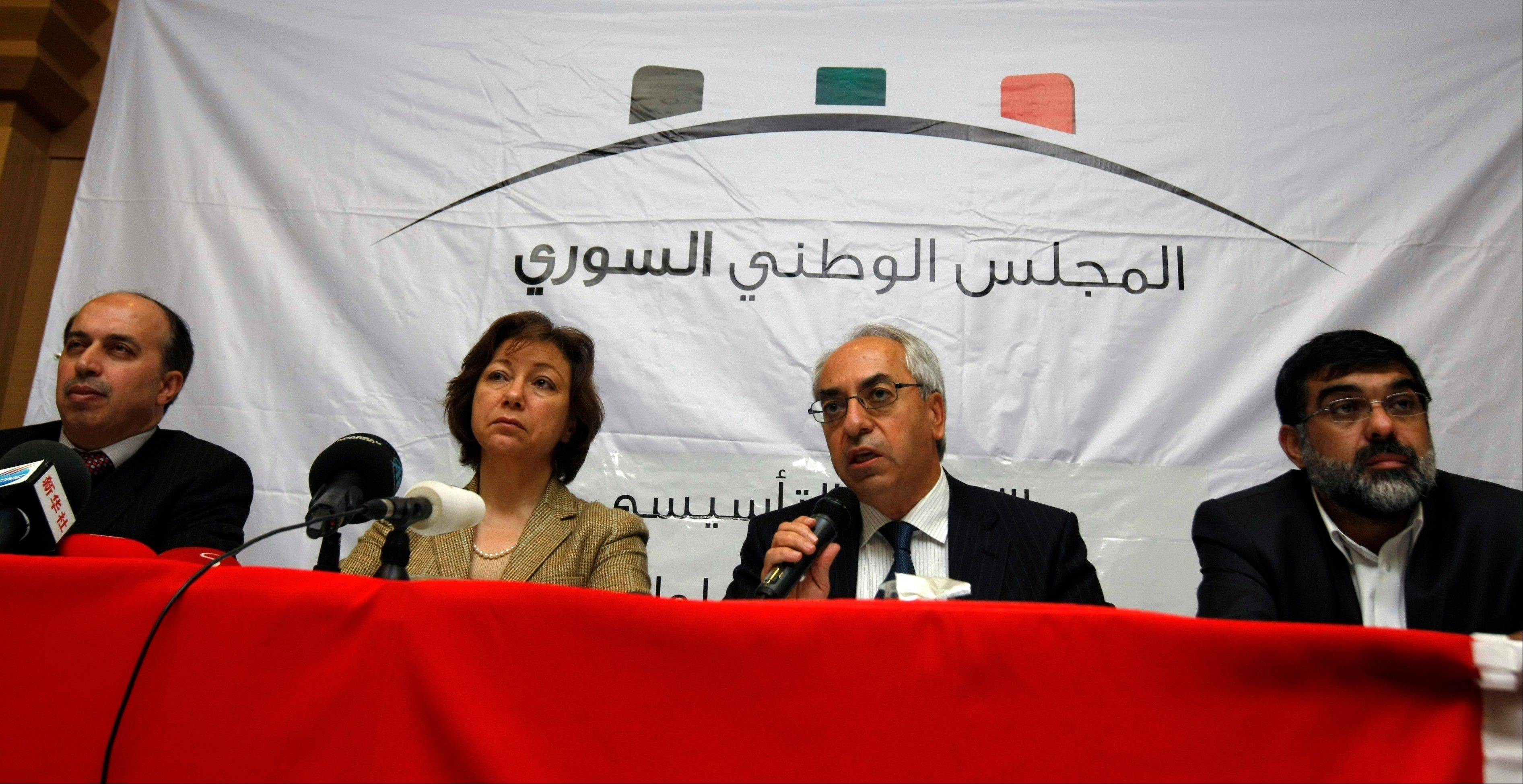From left, Ahmed Ramadan, Bassma Kodmani, Abdulbaset Seida and Imad Aldeen Rashid speak as a group of Syrian opposition members announced a Syrian National Council in their bid to present a united front against President Bashar Assad�s regime, in Istanbul, Turkey.