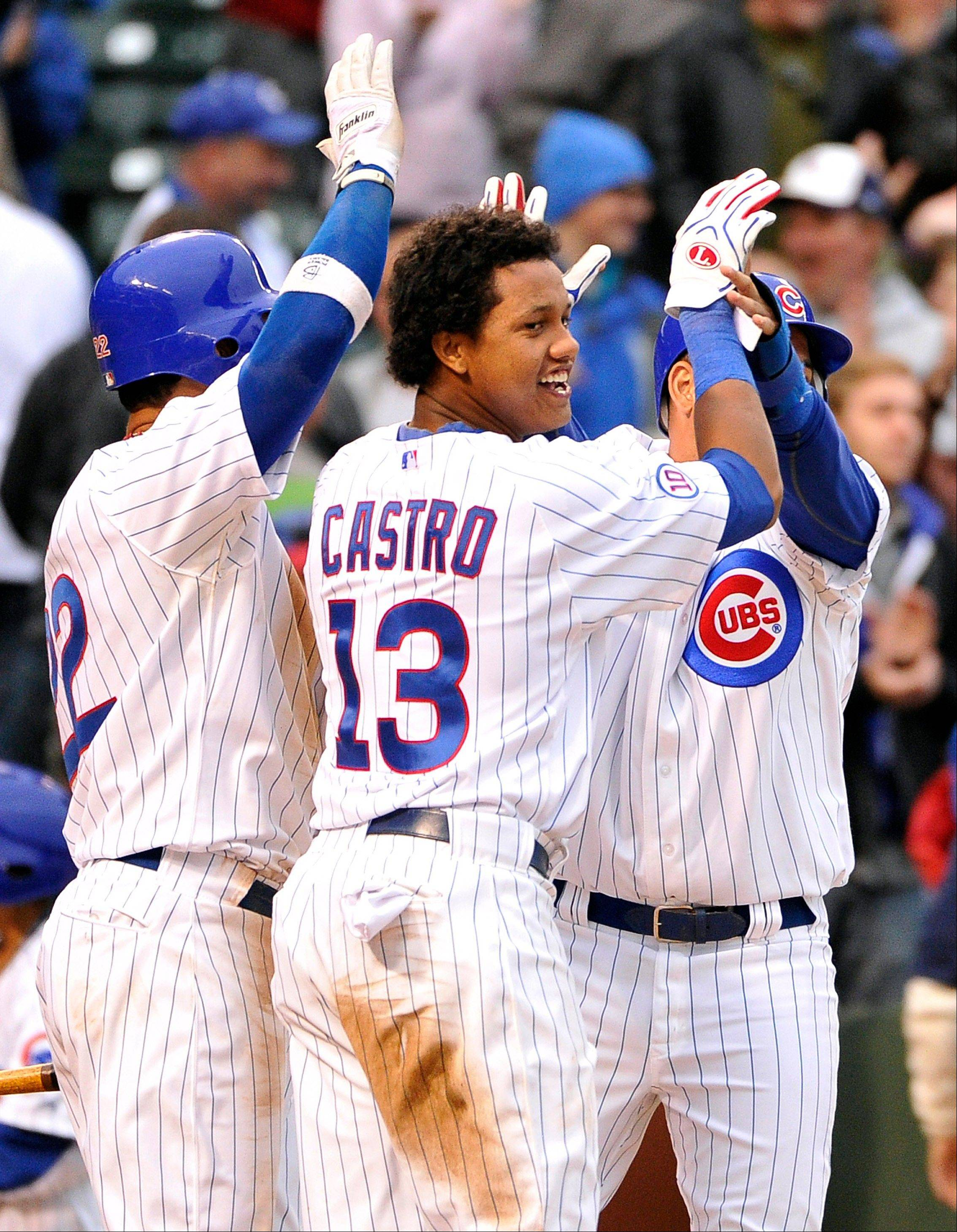 Carlos Pena, Starlin Castro and Aramis Ramirez celebrate their 4-3 win in 12 innings over the Houston Astros Friday at Wrigley Field.