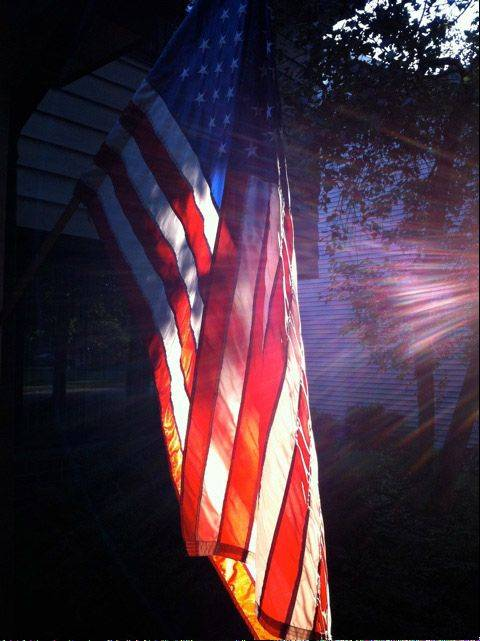 The photo is of the flag at my home's front door. The early morning sunlight on the flag really caught my eye. Knowing good light is fleeting, I grabbed my camera right away and took the photo immediately. I like the ethereal halo glint of sunlight which honors the flag and makes the flag also appear lit from within. The colors are strong, proud and spiritual all at the same time, quite fitting for the flag as we remember September 11th.